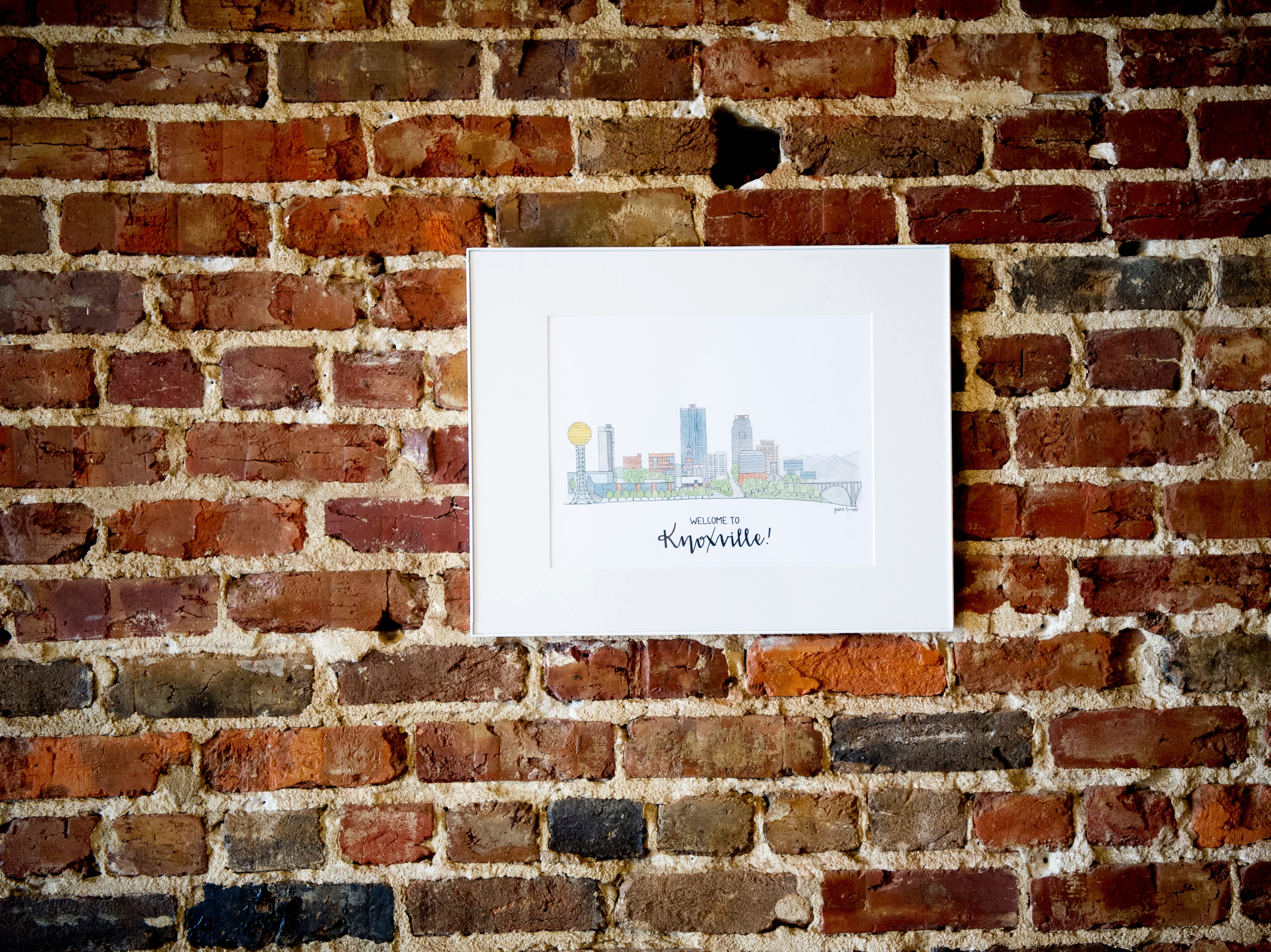 One of the Jacks Ave drawings of downtown Knoxville hangs on the wall at the future Jacks of Knoxville shop at 133c South Gay Street in Knoxville, Tennessee on Friday, January 4, 2019. The shop, which is planned to open in February, will have a strong focus on selling arts and crafts made by local makers.