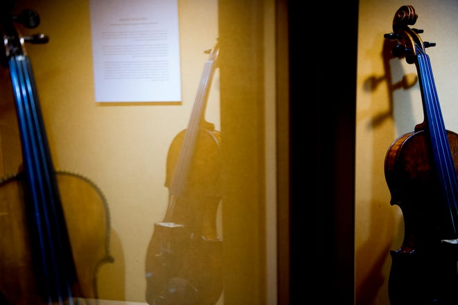 """The Shlomo Mintz and Weichold violins are on display at the """"Violins of Hope"""" exhibit at the University of Tennessee Downtown Gallery, 106 S. Gay St., in Knoxville on Friday, Jan. 4, 2019. The exhibit, from Israel, features 38 violins played by Jewish musicians during the Holocaust. The display runs through Jan. 27."""