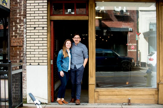 Katherine and Logan Higgins pose for a photo in front of their future Jacks of Knoxville shop at 133c South Gay Street.