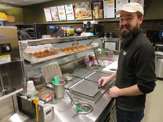 General manager Dakota Grier is ready to serve customers ice cream treats as a new feature of Krispy Kreme.