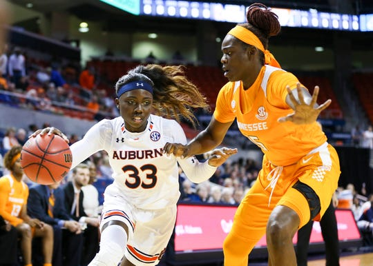 Tennessee's Cheridene Green, right, tries to cut off the drive of Auburn guard Janiah McKay during Thursday's SEC game at Auburn, Ala.