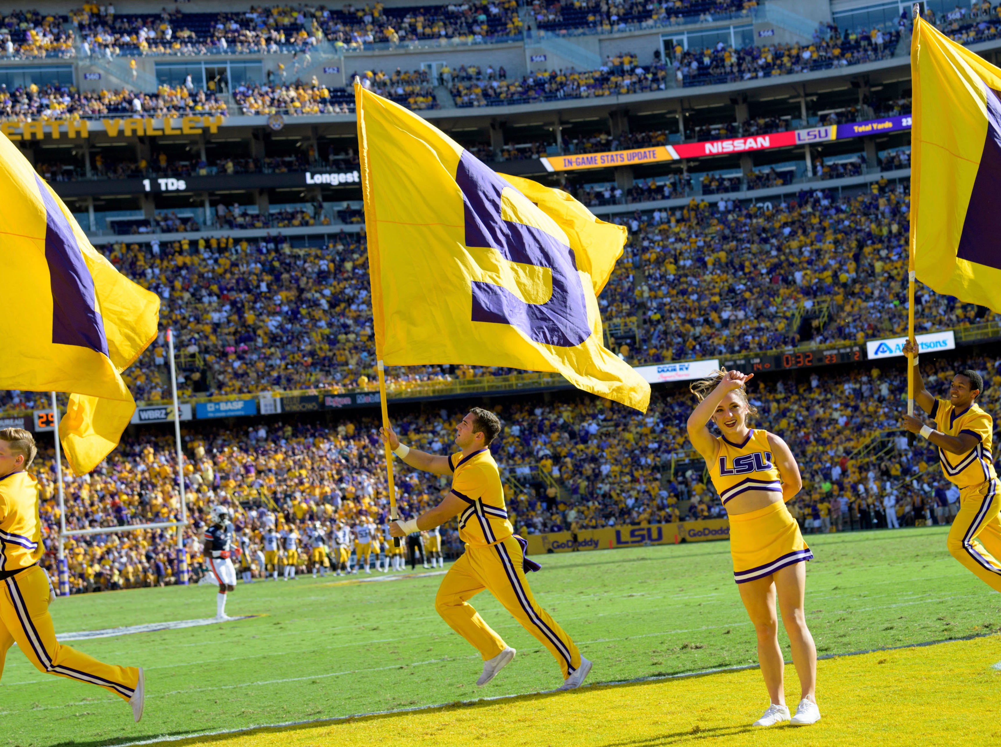 LSU cheerleaders celebrate a touchdown during an NCAA college football game against Auburn in Baton Rouge, La., Saturday, Oct. 14, 2017. (AP Photo/Matthew Hinton)
