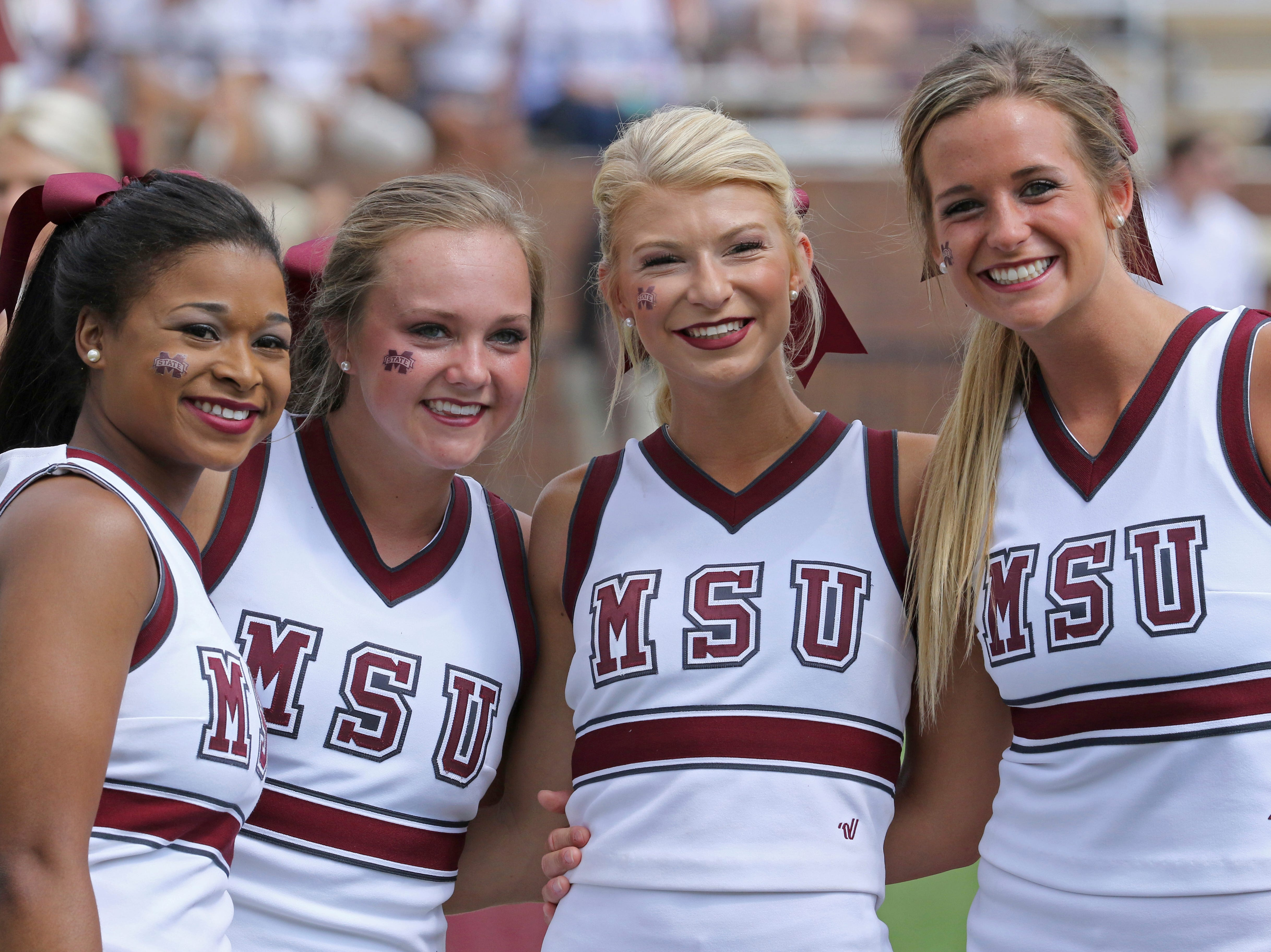 A group of Mississippi State cheerleaders huddle together for a photo during pregame festivities of the NCAA college football game between Mississippi State and Charleston Southern in Starkville, Miss., Saturday, Sept. 2, 2017. (AP Photo/Jim Lytle)