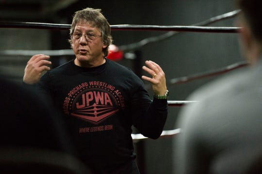 Tom Prichard speaks to attendees during an open house for a new wrestling academy opened by Glenn Jacobs and himself called the Jacobs-Prichard Wrestling Academy, in Knoxville, Thursday, Jan. 3, 2019. Prichard will train prospective professional wrestlers at the academy.