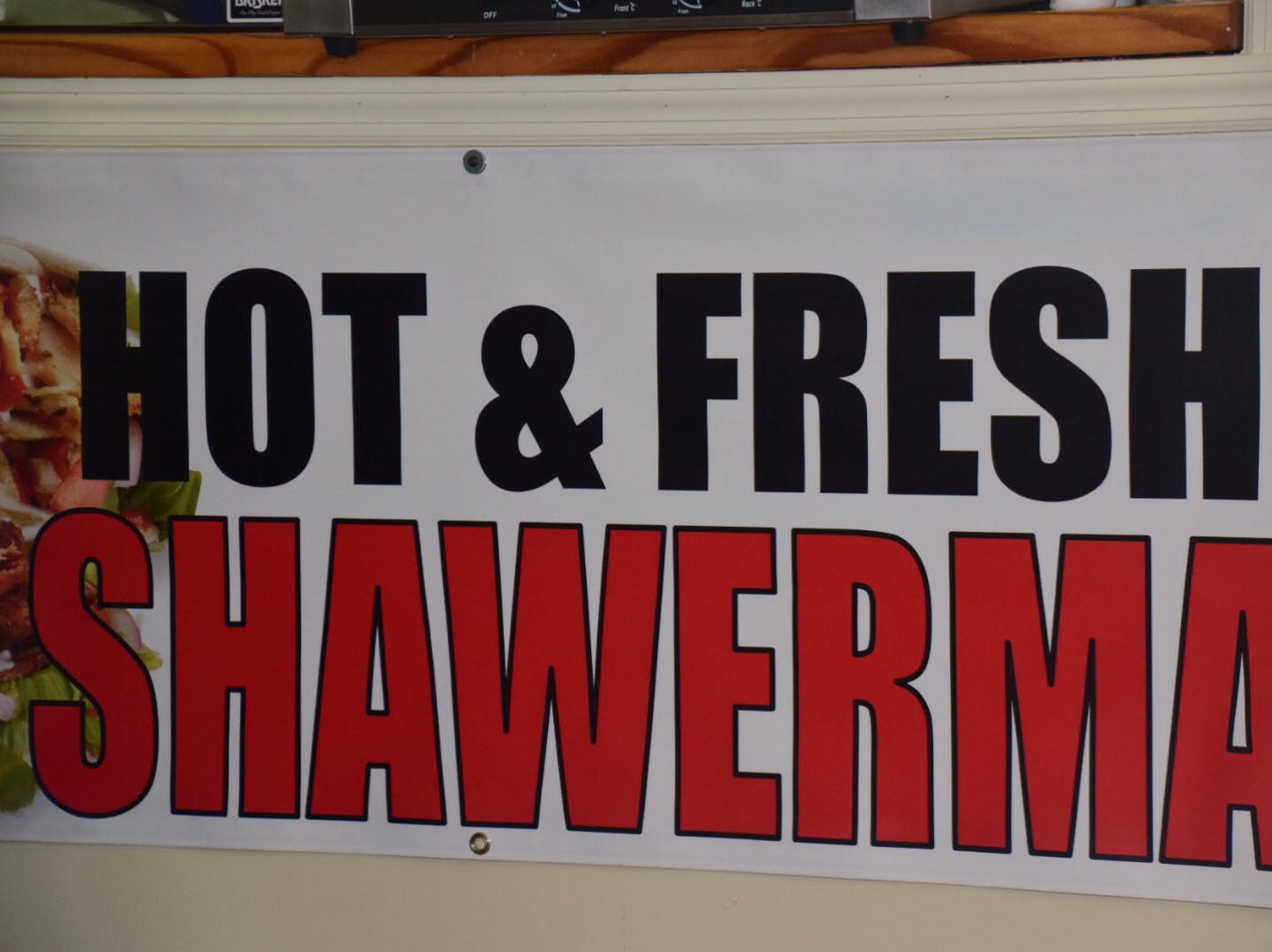 Shawarma is spiced rotisserie chicken or beef shredded and served up over lettuce. It's popular as a salad or wrapped sandwich at Kib Kab Deli Wednesday, Dec. 2.