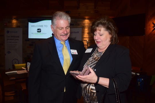 Alan Diskin with WKCE and Terri Mauk with Ontrack Marketing and Design set a one-to-one meeting during a Networking Today International meeting at Corner 16 Friday, Jan. 4.