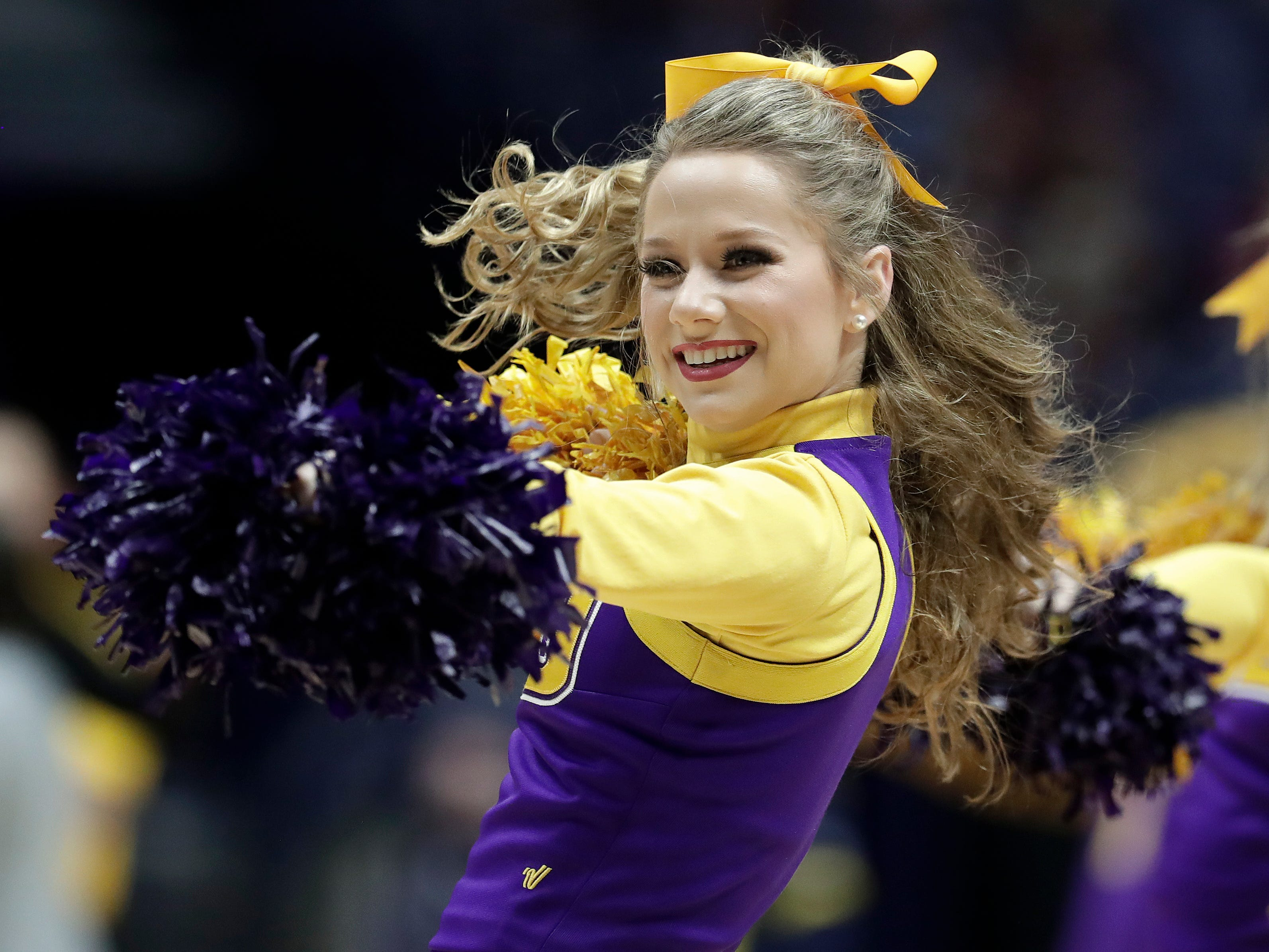An LSU cheerleader performs during an NCAA college basketball game against Texas A&M at the women's Southeastern Conference tournament Friday, March 2, 2018, in Nashville, Tenn. Texas A&M won 75-69. (AP Photo/Mark Humphrey)
