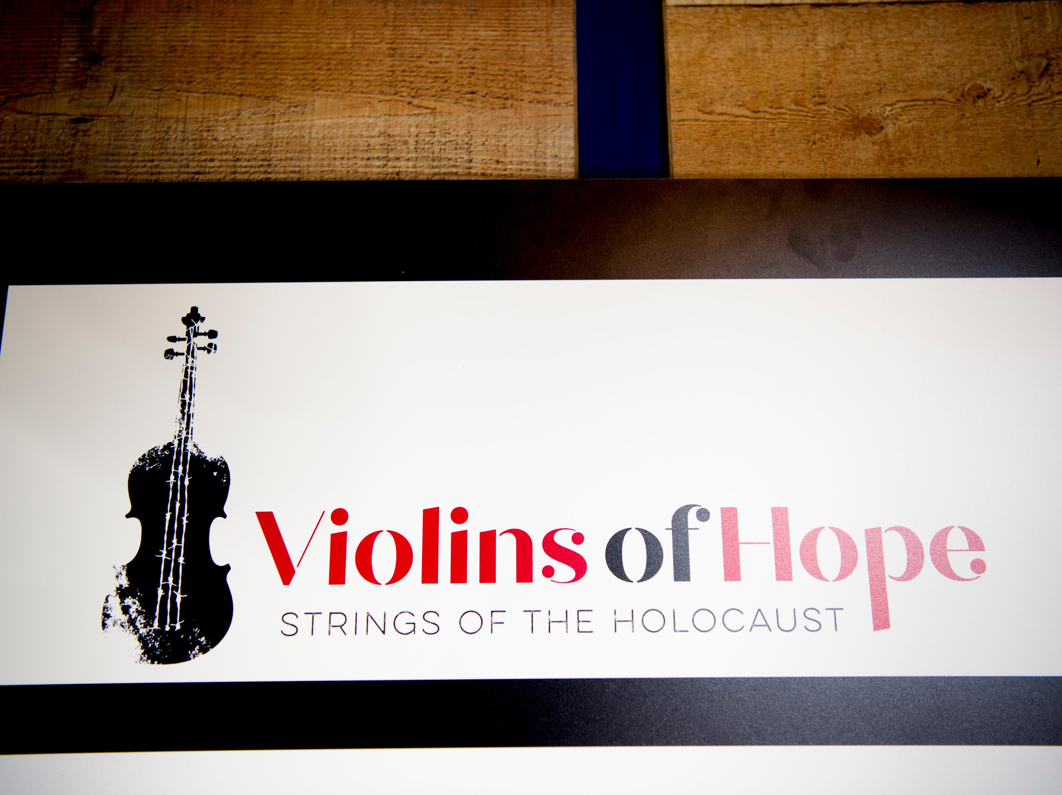 The Violins of Hope logo at the Violins of Hope exhibit at the University of Tennessee Downtown Gallery, 106 S. Gay St., in Knoxville, Tennessee on Friday, January 4, 2019. The exhibit, from Israel, features 38 violins that were played by Jewish musicians during the Holocaust. The display runs from Jan. 4-27.