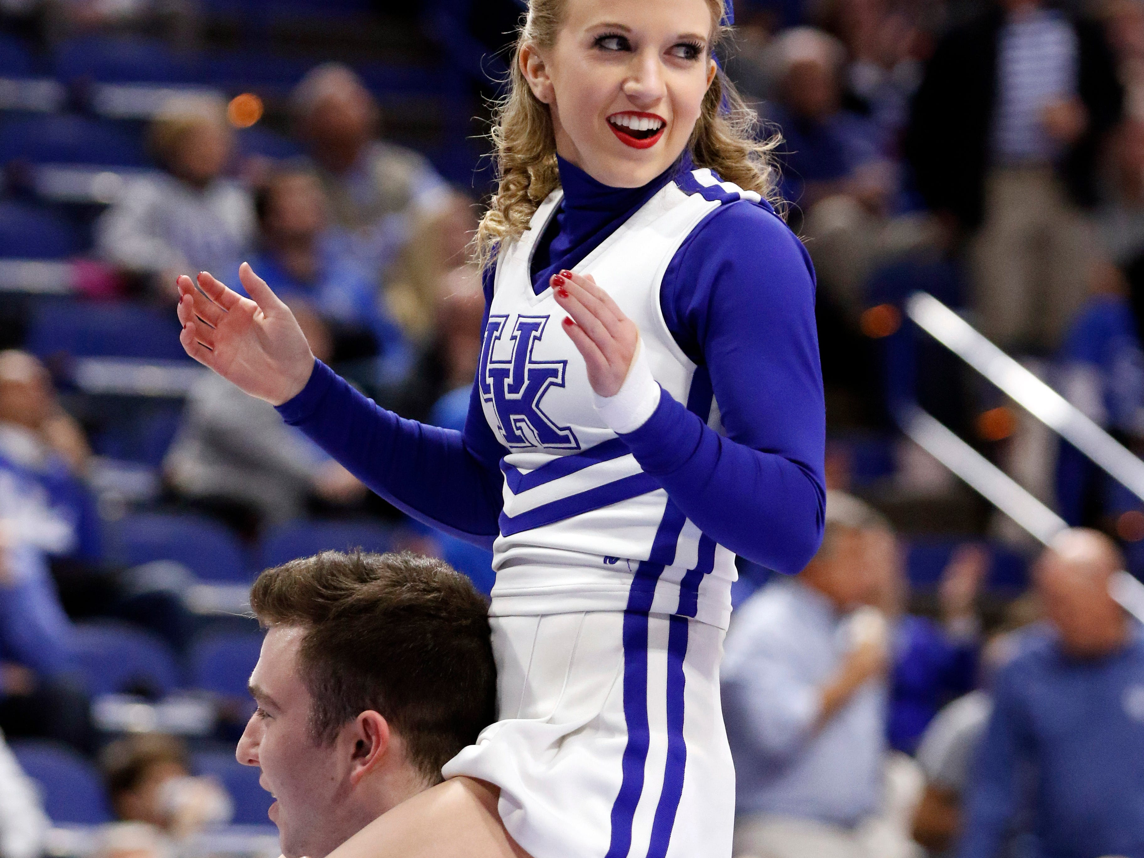 Kentucky cheerleaders perform during the second half of an NCAA college basketball game against Mississippi State, Tuesday, Jan. 23, 2018, in Lexington, Ky. Kentucky won 78-65. (AP Photo/James Crisp)
