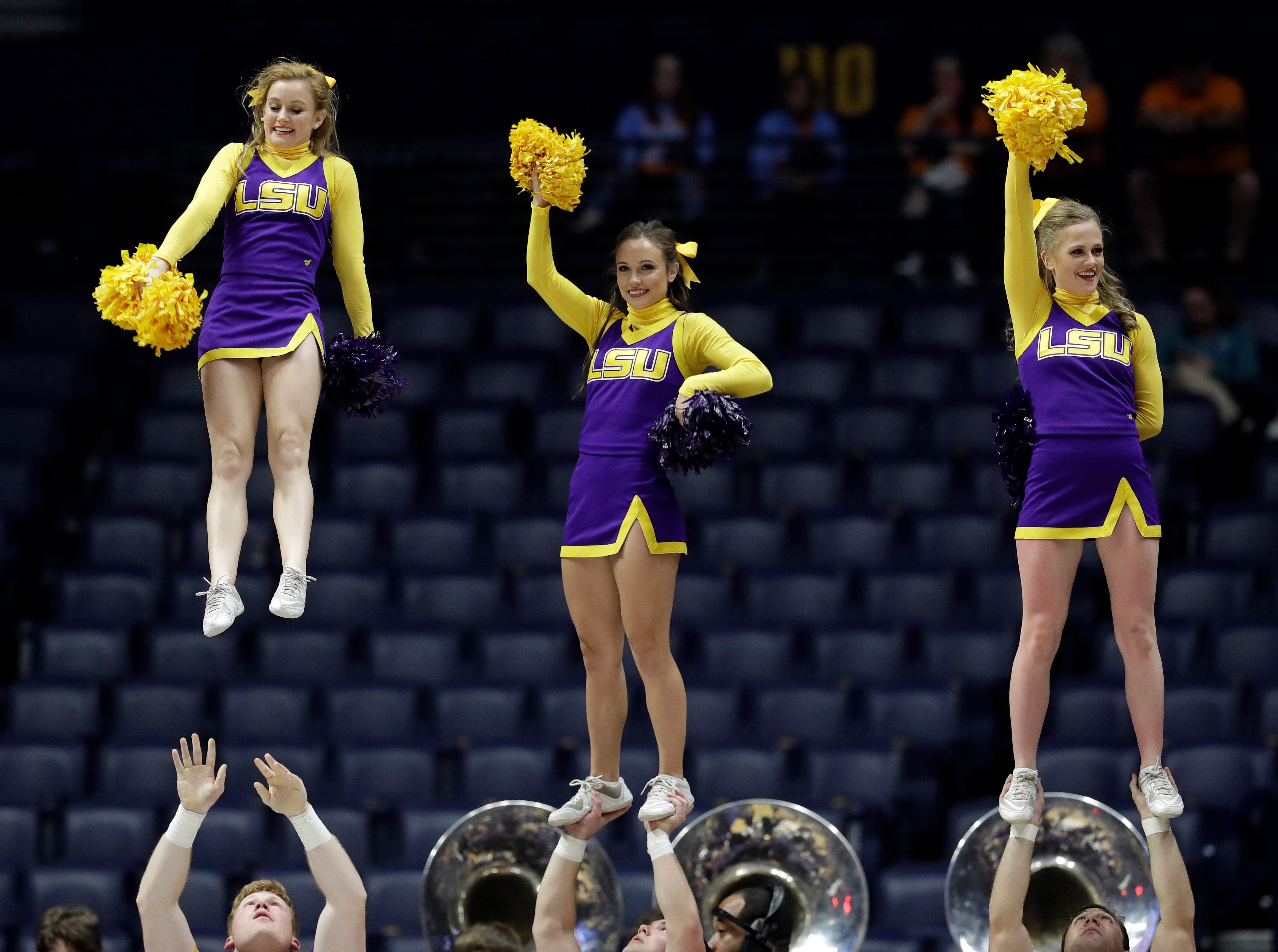 LSU cheerleaders perform during an NCAA college basketball game against Texas A&M at the women's Southeastern Conference tournament Friday, March 2, 2018, in Nashville, Tenn. Texas A&M won 75-69. (AP Photo/Mark Humphrey)