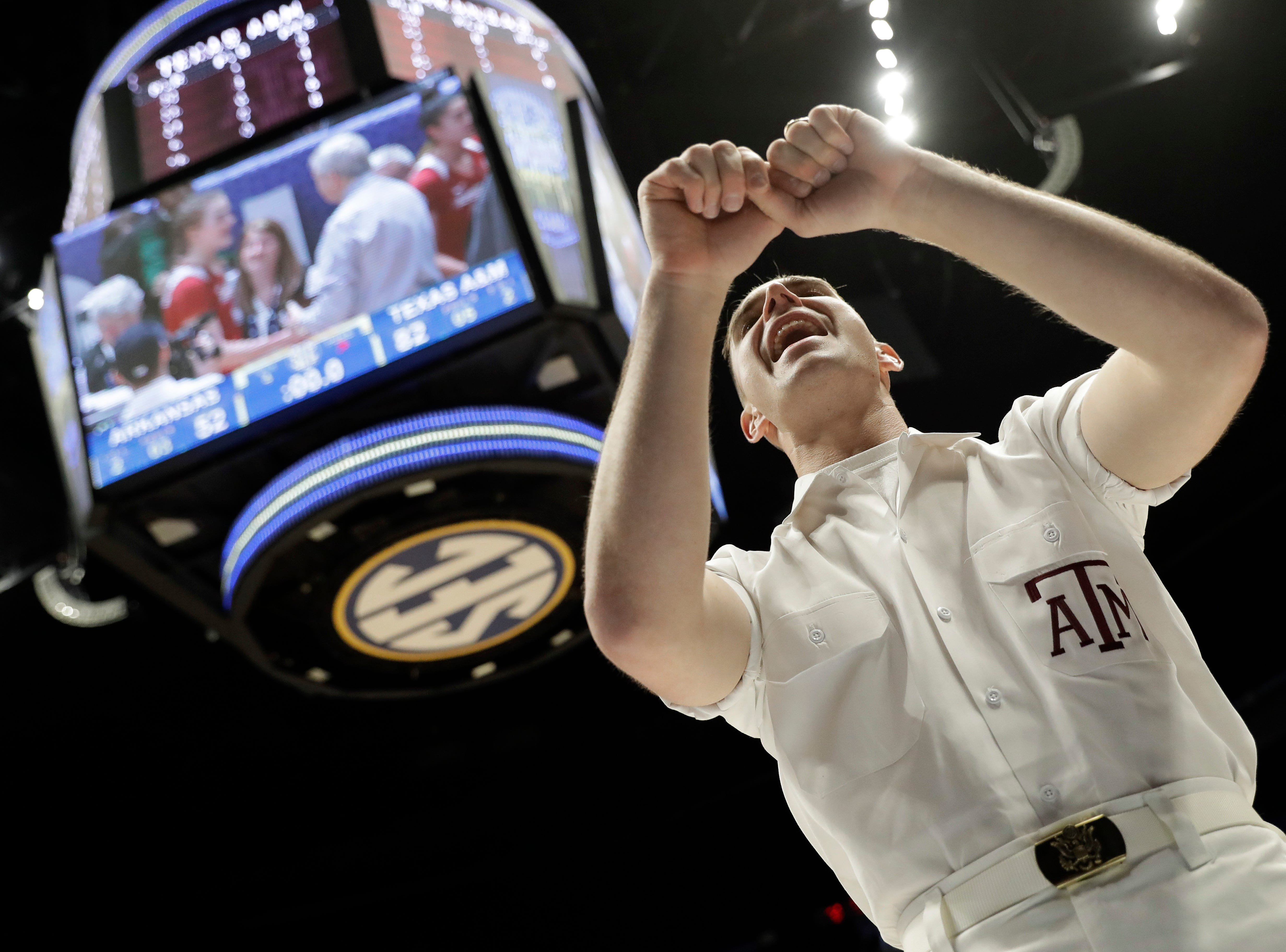 A Texas A&M cheerleader celebrates after a win against Arkansas in an NCAA college basketball game at the women's Southeastern Conference tournament Thursday, March 1, 2018, in Nashville, Tenn. Texas A&M won 82-52. (AP Photo/Mark Humphrey)