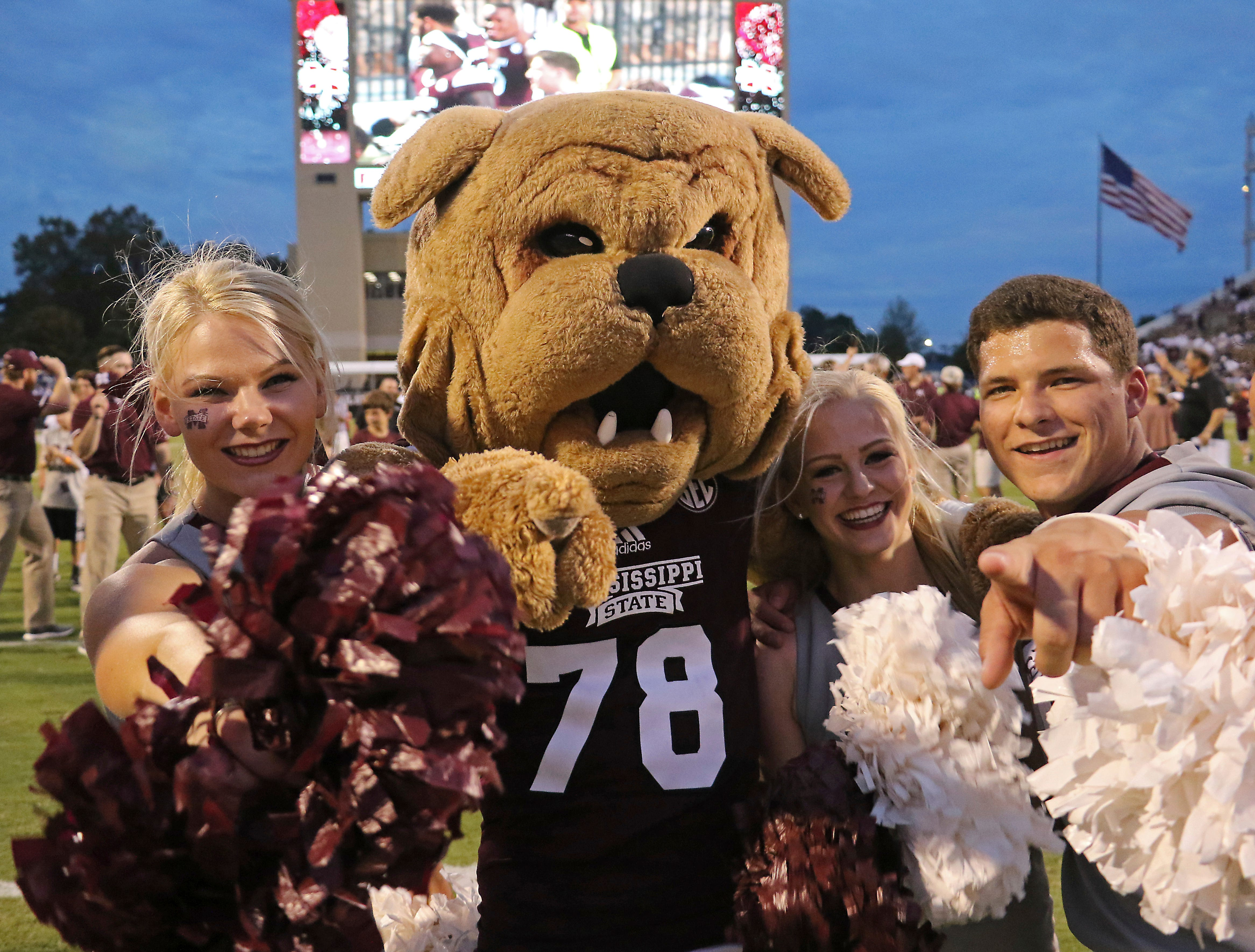 "Mississippi State mascot ""Bully"", second from left celebrates the NCAA college football game win over Kentucky with unknown MSU cheerleaders in Starkville, Miss., Saturday, Oct. 21, 2017. (AP Photo/Jim Lytle)"