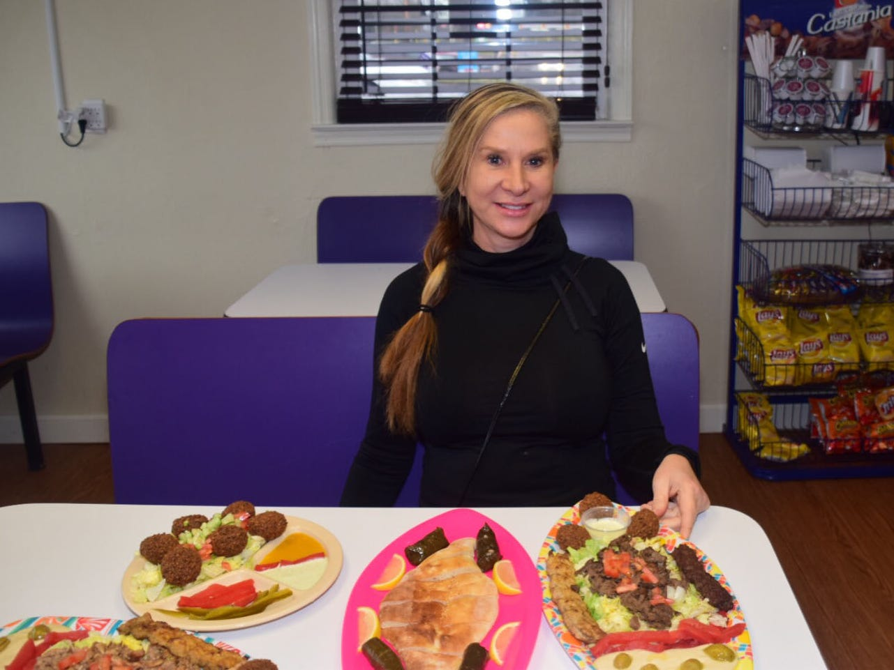 """Mari Falk of Autumn Care Assisted Living came in at just the right time. She gets her choice of platters. """"I came in to check it out. Local business should support local business."""""""