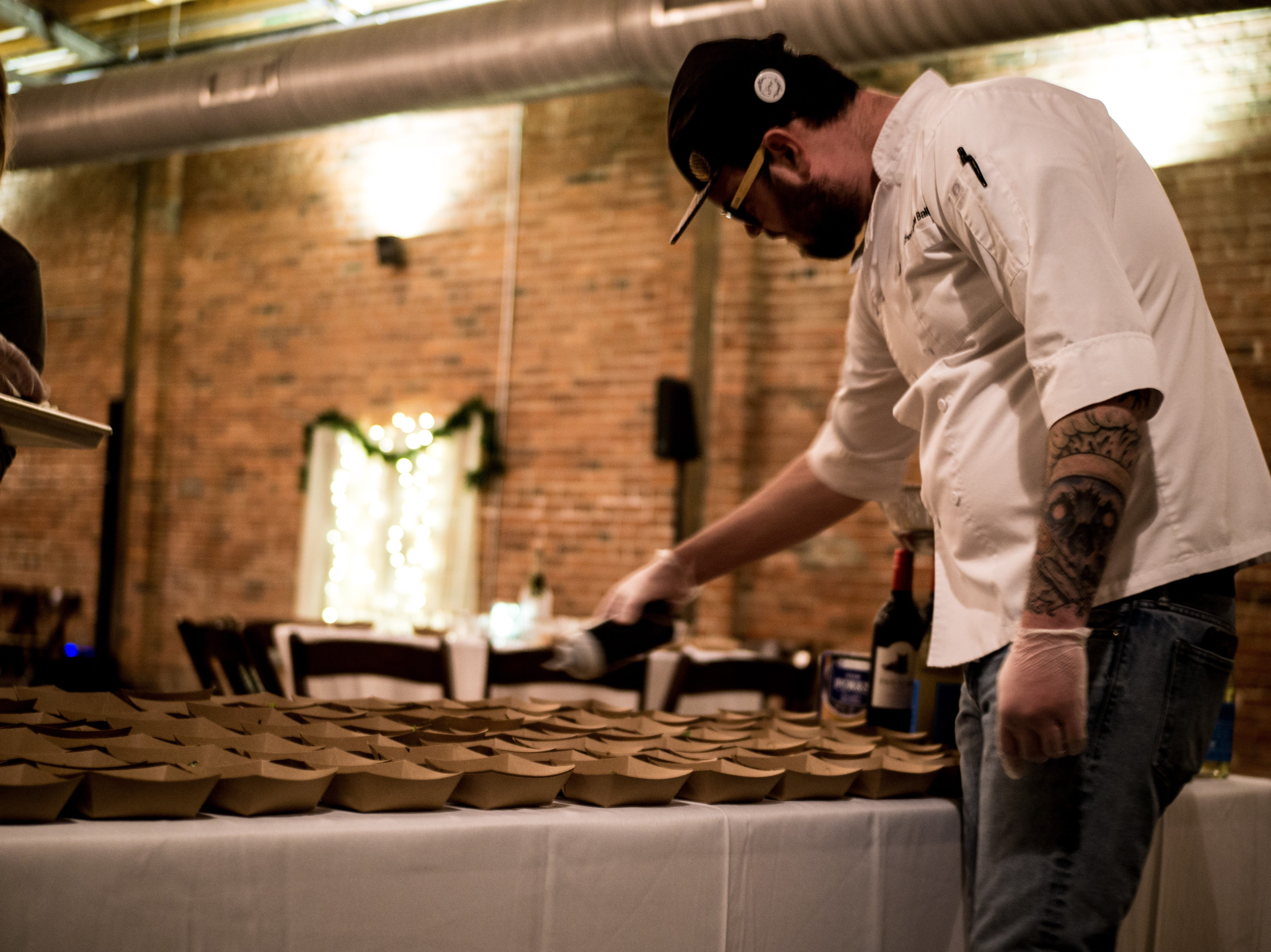 Chef Kendale Ball prepares food at a catering event.