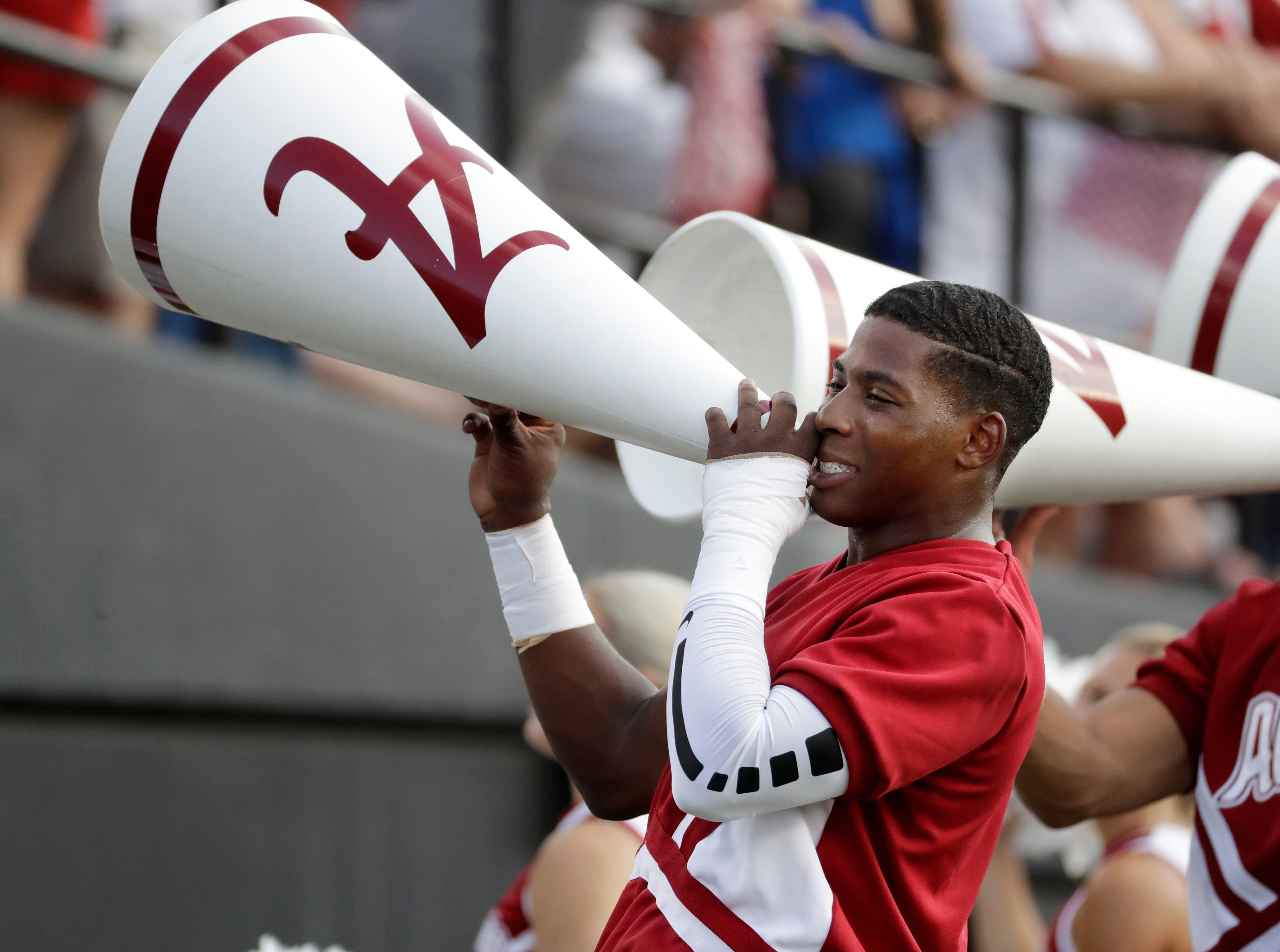 Alabama cheerleaders yell in the second half of an NCAA college football game between Alabama and Vanderbilt Saturday, Sept. 23, 2017, in Nashville, Tenn. (AP Photo/Mark Humphrey)