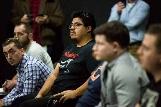 At center Alex Lopez of California listens during an open house for a new wrestling academy opened by Glenn Jacobs and Tom Prichard called the Jacobs-Prichard Wrestling Academy, in Knoxville Thursday, Jan. 3, 2019.
