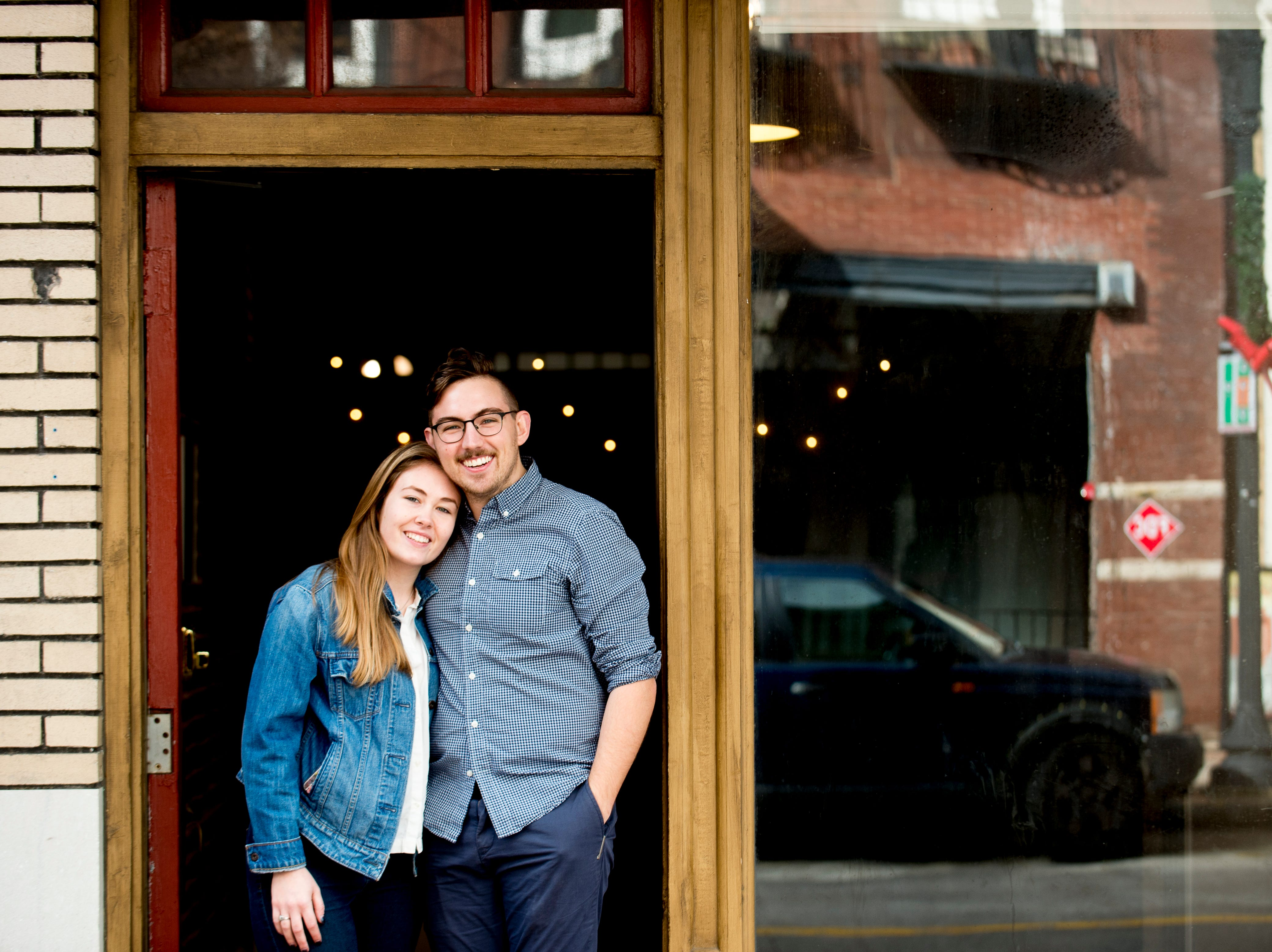 Katherine and Logan Higgins pose for a photo in front of their future Jacks of Knoxville shop at 133c South Gay Street in Knoxville, Tennessee on Friday, January 4, 2019. The shop, which is planned to open in February, will have a strong focus on selling arts and crafts made by local makers.