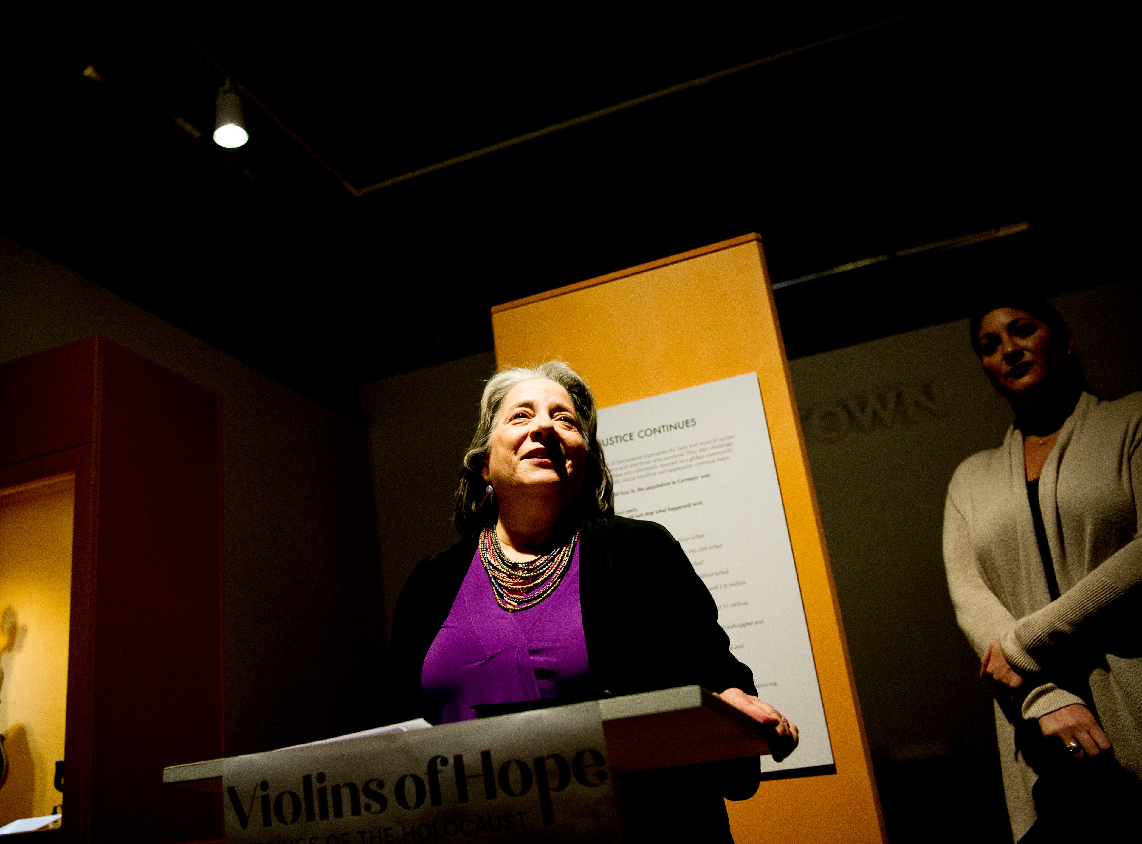 Knoxville Mayor Madeline Rogero speaks at the Violins of Hope exhibit at the University of Tennessee Downtown Gallery, 106 S. Gay St., in Knoxville, Tennessee on Friday, January 4, 2019. The exhibit, from Israel, features 38 violins that were played by Jewish musicians during the Holocaust. The display runs from Jan. 4-27.