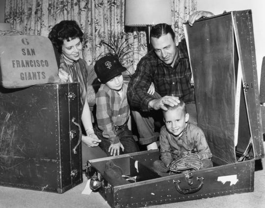Possibly at the instigation of the photographer, San Francisco Giant catcher Ed Bailey packs his son Joe in a suitcase on Feb. 11, 1962. A native of Strawberry Plains and a future Knoxville City Councilman, Bailey was getting ready for spring training. Wife Betty Lou and oldest son Jeff  observe. (NEWS SENTINEL ARCHIVE)