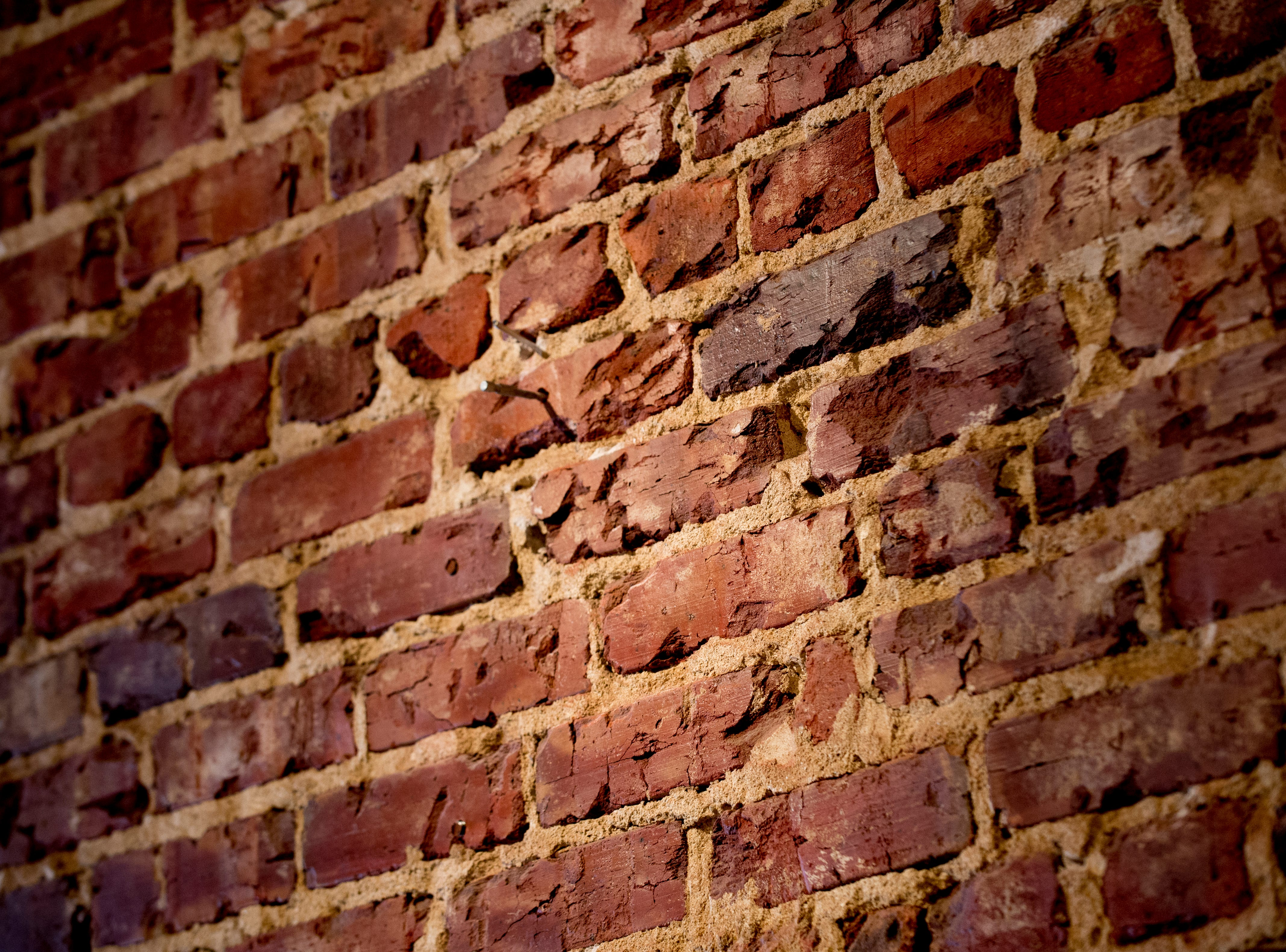 The original brick wall is an attraction of the future Jacks of Knoxville shop at 133c South Gay Street in Knoxville, Tennessee on Friday, January 4, 2019. The shop, which is planned to open in February, will have a strong focus on selling arts and crafts made by local makers.