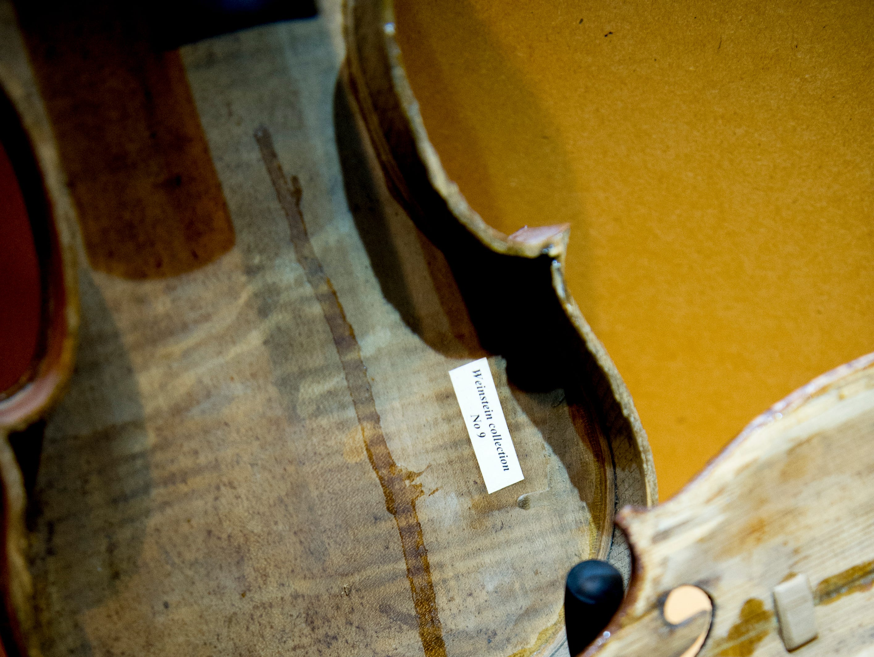 """An unrepaired violin is on display at the """"Violins of Hope"""" exhibit at the University of Tennessee Downtown Gallery, 106 S. Gay St., in Knoxville on Jan. 4, 2019."""