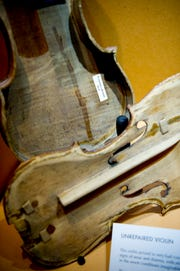 "An unrepaired violin is on display at the ""Violins of Hope"" exhibit at the University of Tennessee Downtown Gallery, 106 S. Gay St., in Knoxville on Jan. 4, 2019."