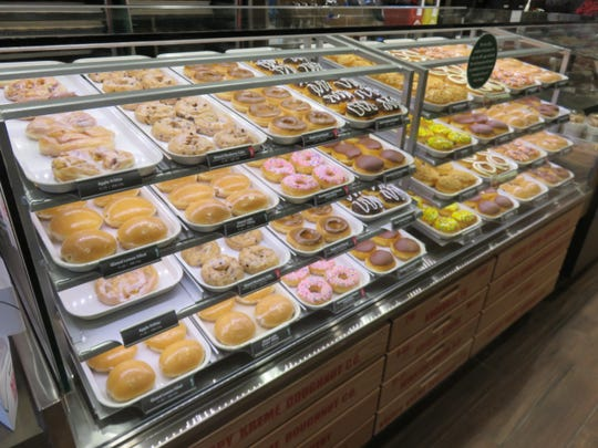 Different kinds of doughnuts are sold at the Krispy Kreme store by UT.
