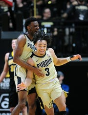 Boilermakers guard Carsen Edwards (3) celebrates along with Purdue Boilermakers forward Aaron Wheeler (1) against the Iowa Hawkeyes in the second half at Mackey Arena.