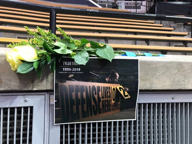 A sign and flowers hang near the basketball court at Mackey Arena before the Purdue vs. Iowa men's basketball game on Jan. 3, 2019.