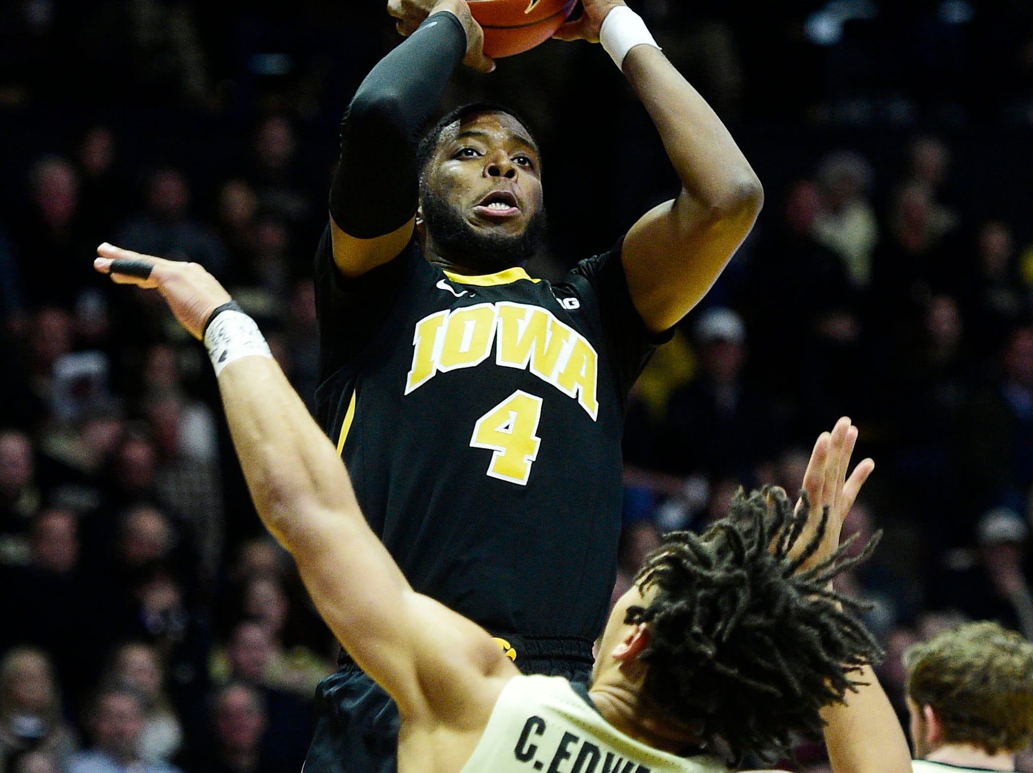 Jan 3, 2019; West Lafayette, IN, USA;  Iowa Hawkeyes guard Isaiah Moss (4) shoots over Purdue Boilermakers guard Carsen Edwards (3) in the first half at Mackey Arena. Mandatory Credit: Thomas J. Russo-USA TODAY Sports