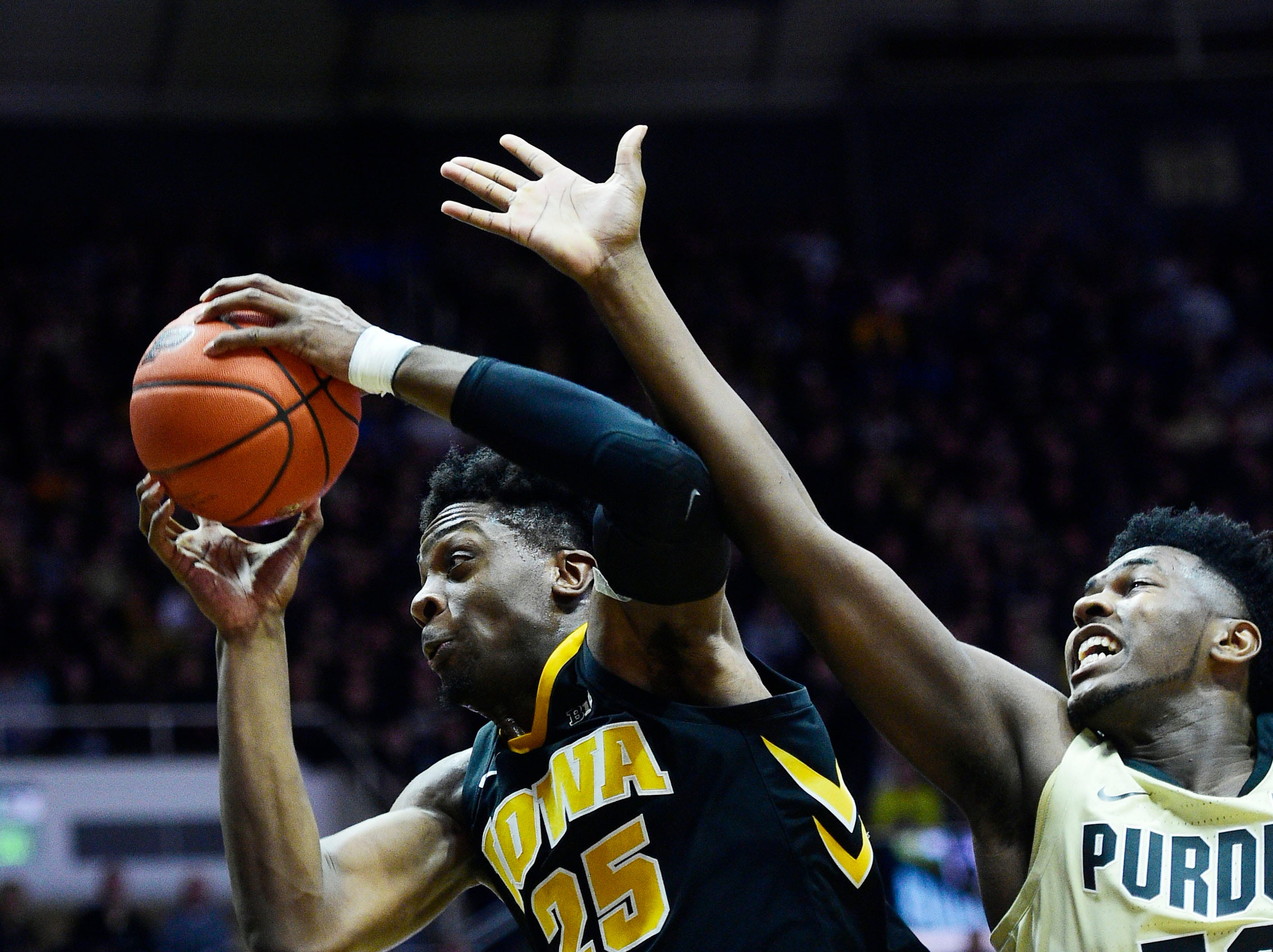 Jan 3, 2019; West Lafayette, IN, USA;  Iowa Hawkeyes forward Tyler Cook  (25) fights for possession of the ball in the first half against the Purdue Boilermakers forward Trevor Williams (50) at Mackey Arena. Mandatory Credit: Thomas J. Russo-USA TODAY Sports