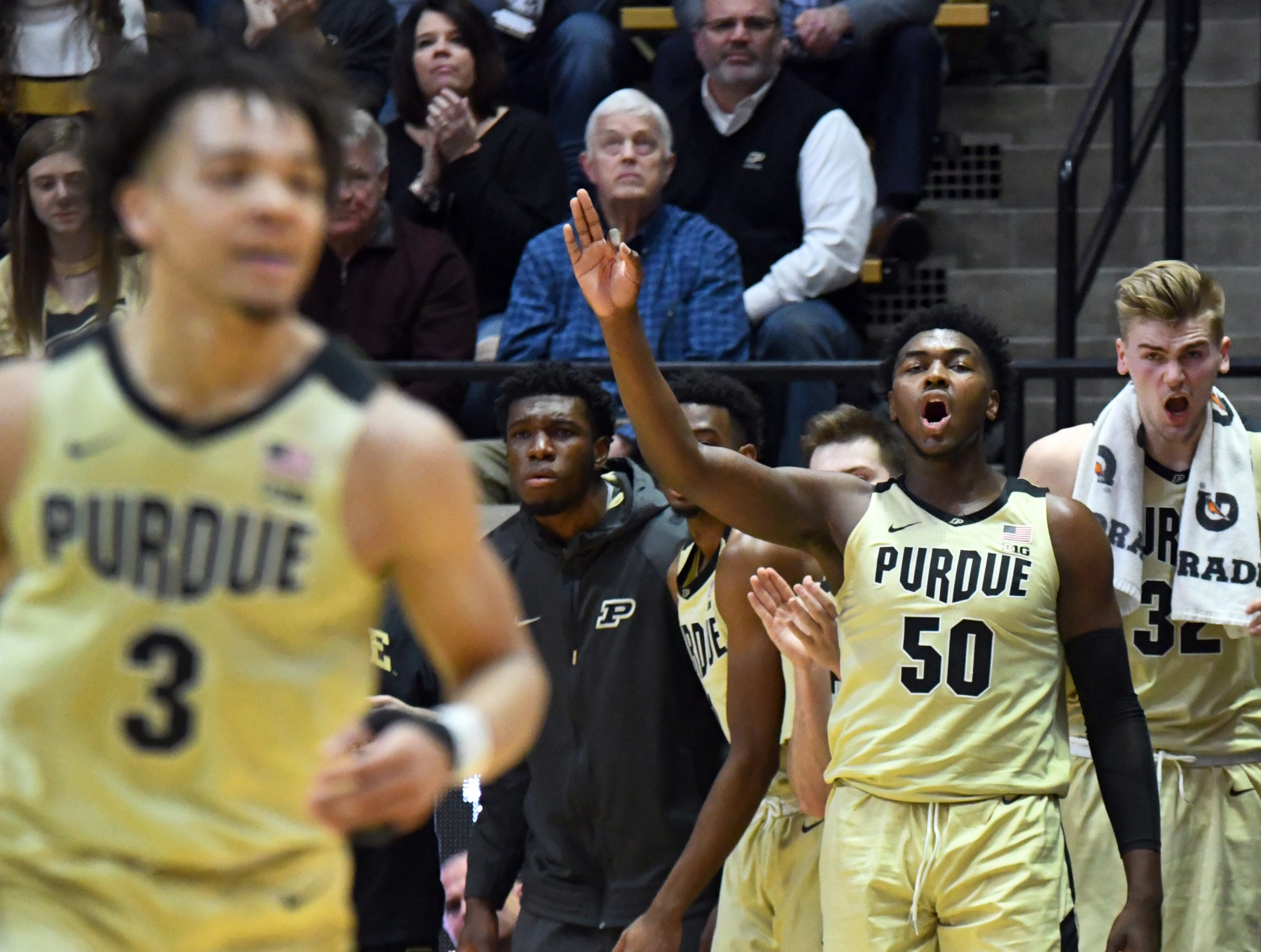 Purdue freshman Trevion Williams (50) and Matt Haarms celebrate a Carsen Edwards 3-pointer.