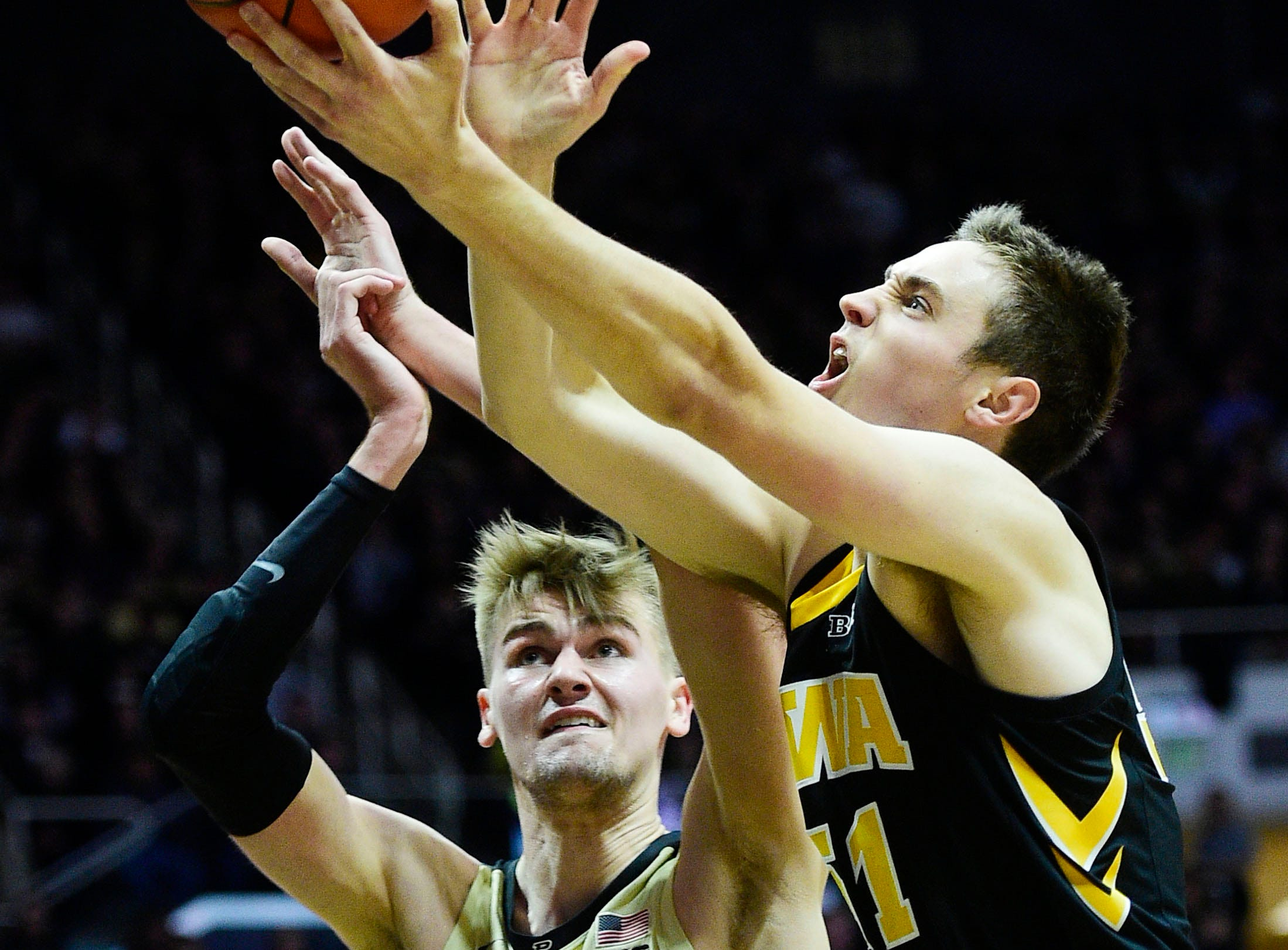 Jan 3, 2019; West Lafayette, IN, USA;  Iowa Hawkeyes forward Nicholas Baer  (51) is fouled in the first half by Purdue Boilermakers center Matt Haarms (32) at Mackey Arena. Mandatory Credit: Thomas J. Russo-USA TODAY Sports