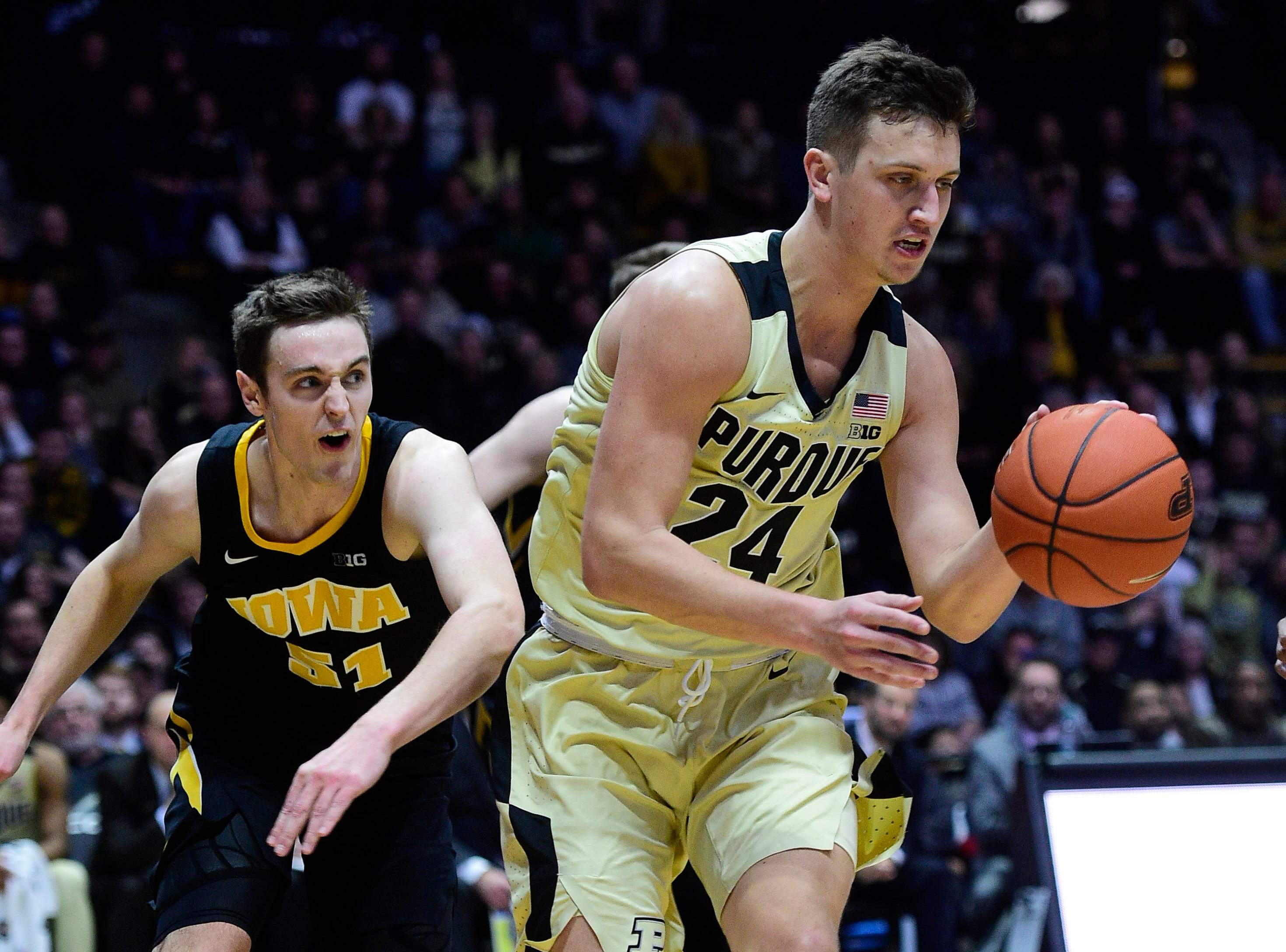 Jan 3, 2019; West Lafayette, IN, USA; Purdue Boilermakers   forward Grady Eifert (24) dribbles past Iowa Hawkeyes forward Nicholas Baer (51)  in the second half at Mackey Arena. Mandatory Credit: Thomas J. Russo-USA TODAY Sports