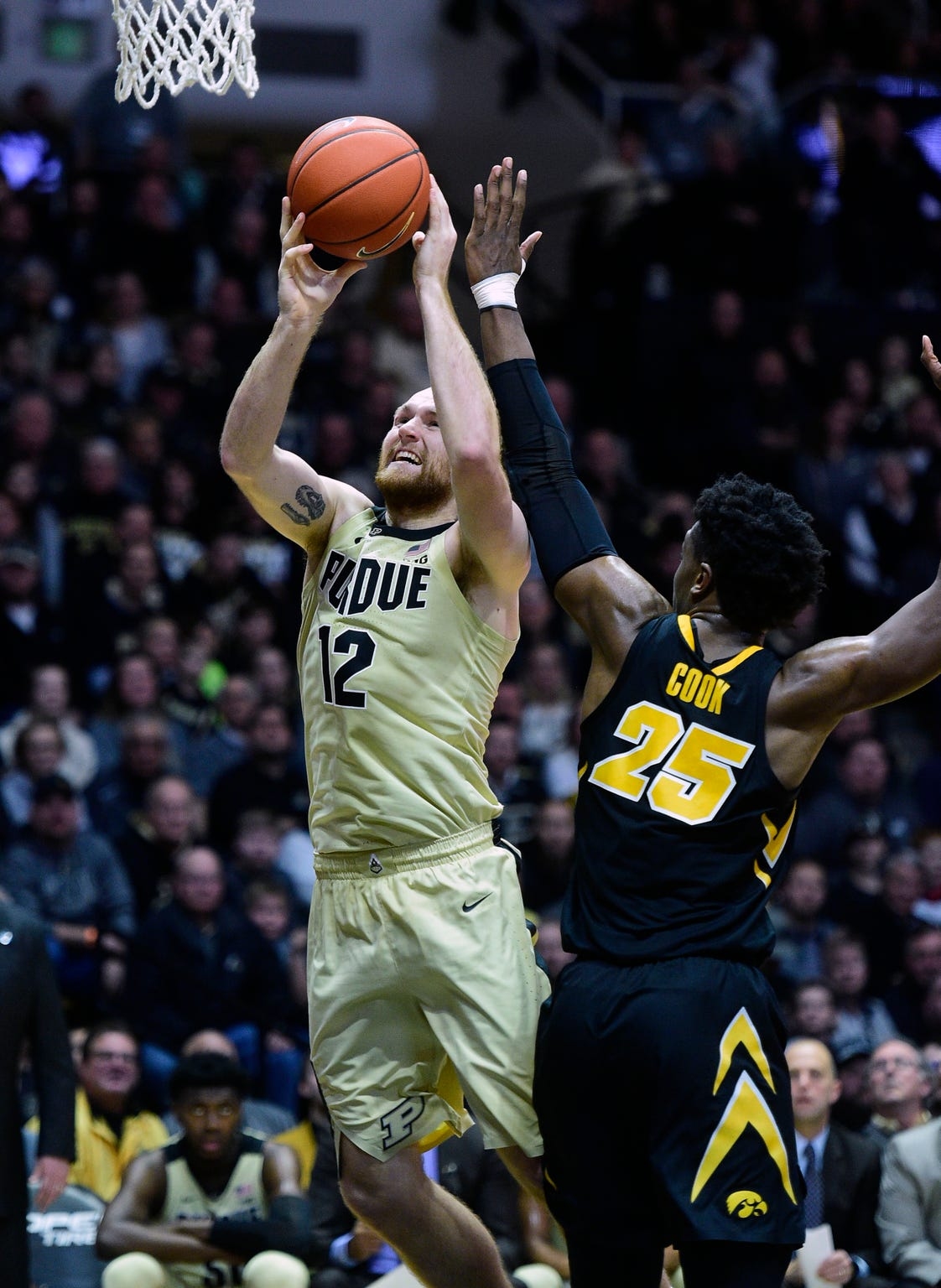 Jan 3, 2019; West Lafayette, IN, USA; Purdue Boilermakers   forward Evan Boudreaux (12) shoots a jumper over Iowa Hawkeyes guard Tyler Cook (25)  in the second half at Mackey Arena. Mandatory Credit: Thomas J. Russo-USA TODAY Sports