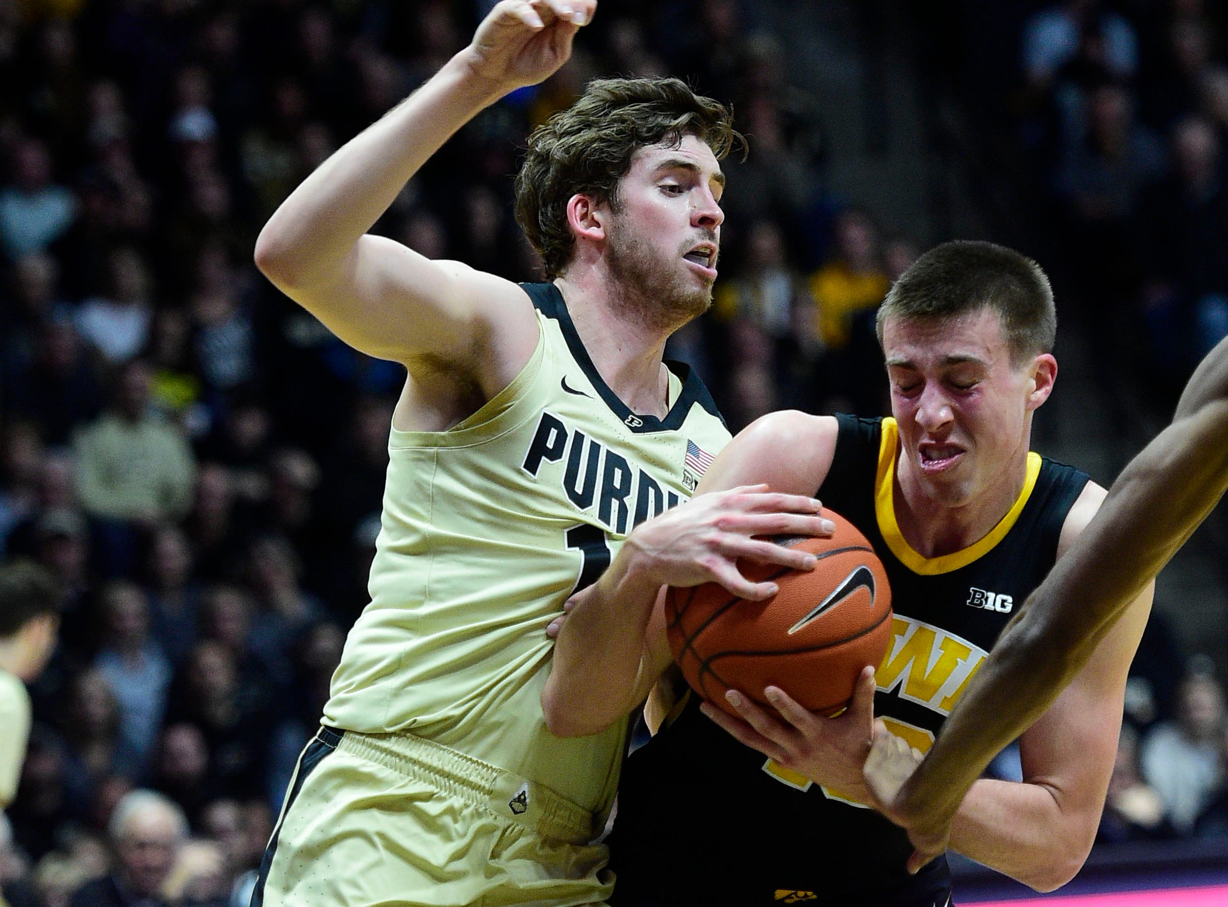 Jan 3, 2019; West Lafayette, IN, USA;  Iowa Hawkeyes guard Joe Weiskamp  (10) drives against Purdue Boilermakers guard Ryan Cline (14) in the first half at Mackey Arena. Mandatory Credit: Thomas J. Russo-USA TODAY Sports