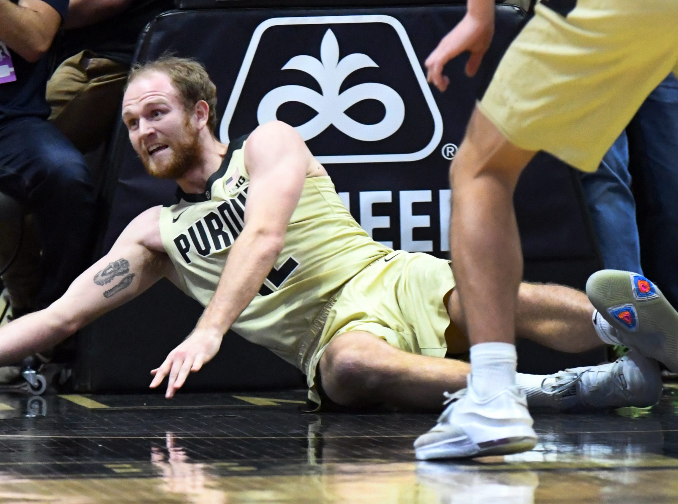 Purdue center Evan Boudreaux dives for a loose ball.