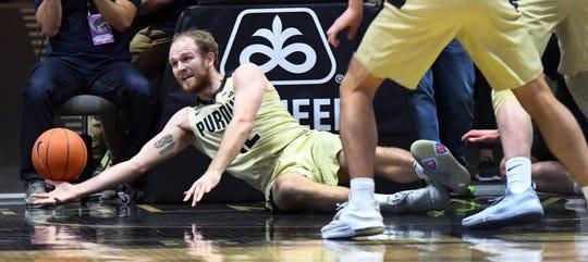 Purdue center Evan Boudreaux dives for a loose ball.