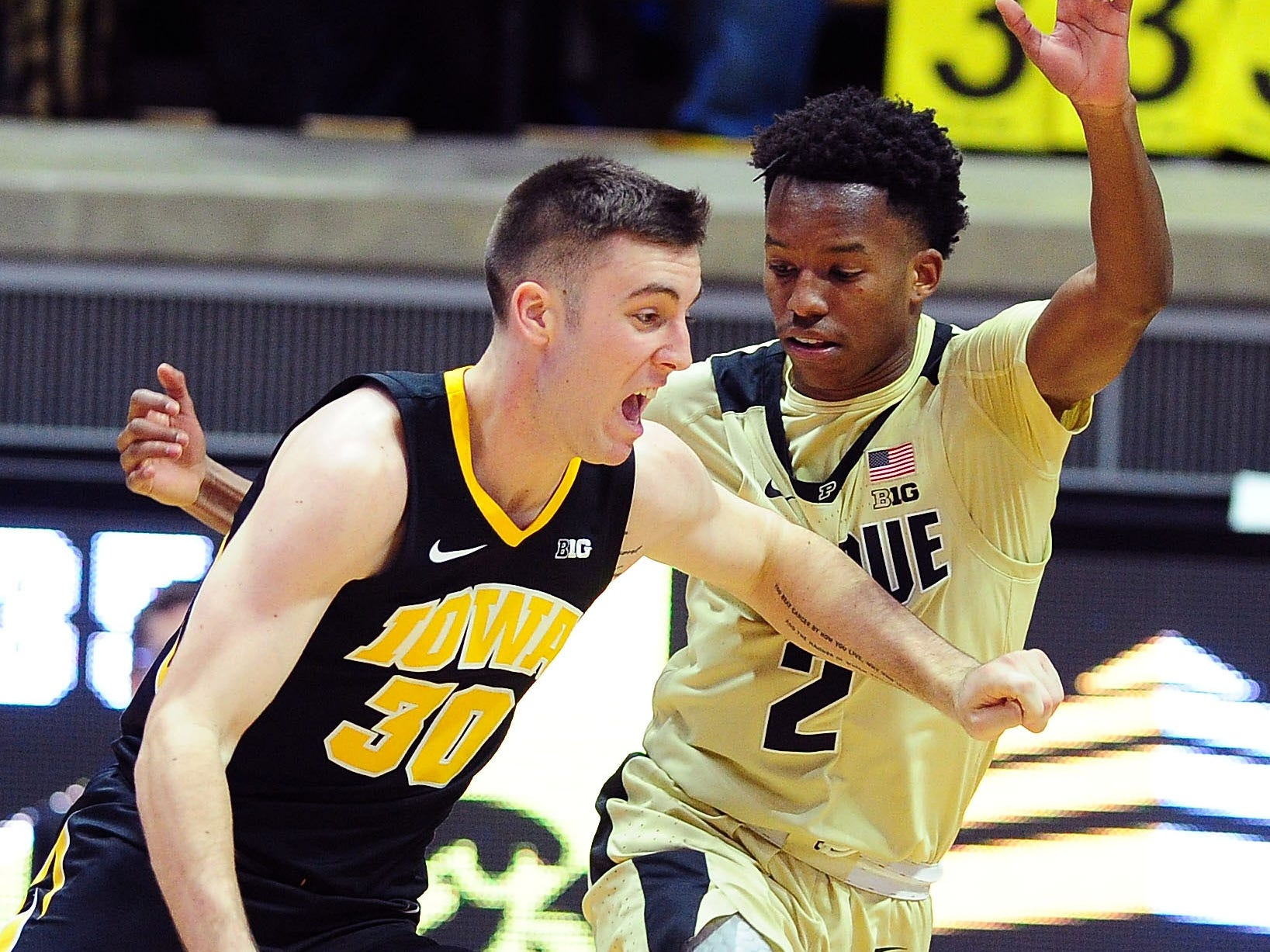 Jan 3, 2019; West Lafayette, IN, USA; Iowa Hawkeyes guard Connor McCaffery  (30) drives toward the basket against Purdue Boilermakers guard Eric Hunter (2) in the second half at Mackey Arena. Mandatory Credit: Thomas J. Russo-USA TODAY Sports