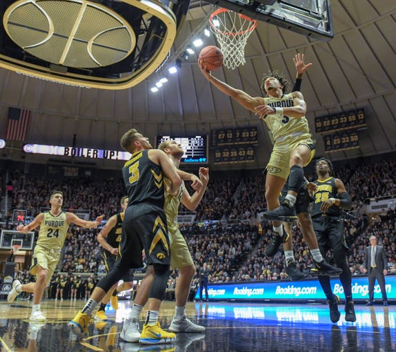 Purdue's Carsen Edwards slides in for two points in the first half against Iowa in West Lafayette on Thursday January 3, 2019.