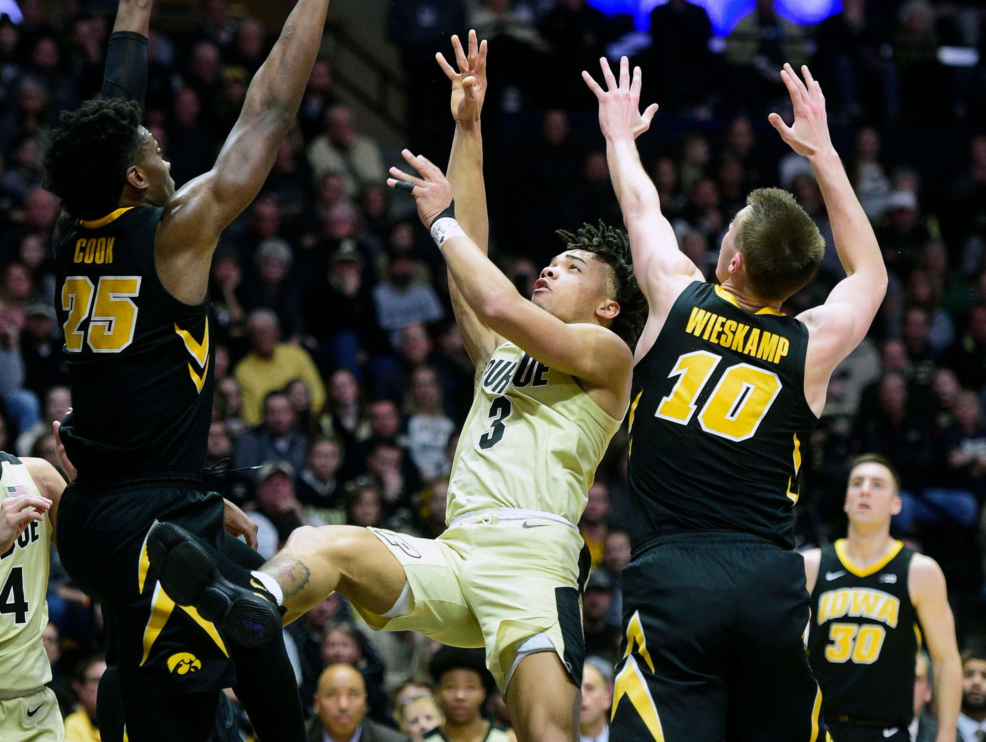 Jan 3, 2019; West Lafayette, IN, USA; Purdue Boilermakers   guard Carsen Edwards (3) goes up to the basket against  Iowa Hawkeyes guard Tyler Cook (25) and Iowa Hawkeyes guard Joe Weiskamp (10)  in the second half at Mackey Arena. Mandatory Credit: Thomas J. Russo-USA TODAY Sports