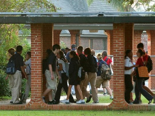 Students walk through the Comeaux High campus.