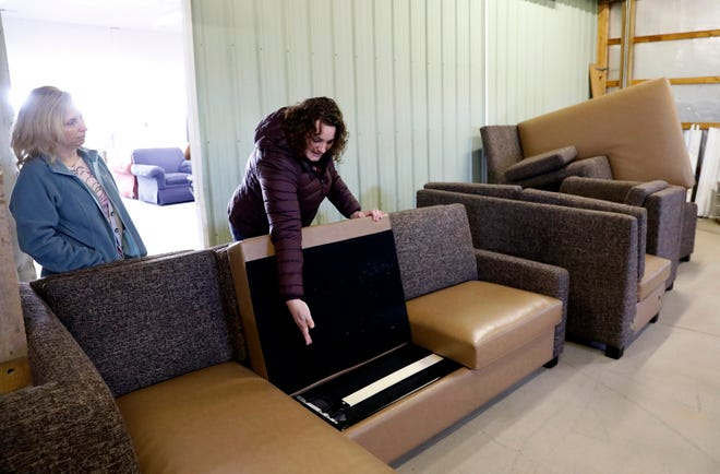 Tammy Myers, left, co-founder of Compassion Furniture Bank, and Michelle Hill, secretary of the nonprofit's board, talk about some of the furniture that has been donated to the newly formed organization Friday, Jan. 4, 2019, in Stoutsville. The group provides furniture to people in need on a referral basis. Tammy Myers and her husband Seth Myers founded the group in 2018.
