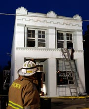 Bremen-Rushcreek Township Fire Chief William Duvall uses a radio to talk to firefighters inside of 8516 Main St. Thursday, Jan. 3, 2019, in Rushville. A woman who was found in an upstairs apartment was flown to Ohio State University Wexner Medical Center for treatment, according the Bremen-Rushcreek Fire Chief William Duvall. The woman's name and condition weren't immediately available.
