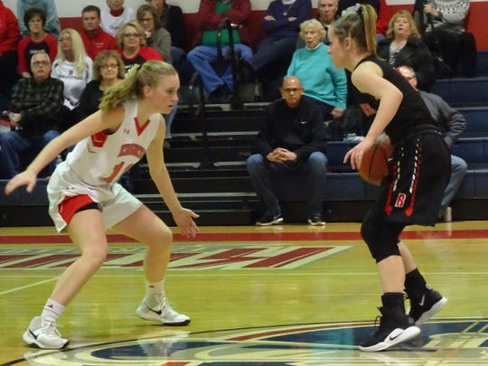 Fairfield Christian Academy's Emma Sears plays defense against Bishop Rosecrans guard Claire Creeks.