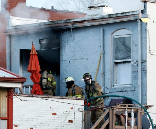 Firefighters enter an apartment on the second floor of a building Thursday, Jan. 3, 2019, at 8516 Main St. in Rushville. A woman who was found in an upstairs apartment was flown to Ohio State University Wexner Medical Center for treatment, according the Bremen-Rushcreek Fire Chief William Duvall. The woman's name and condition weren't immediately available.