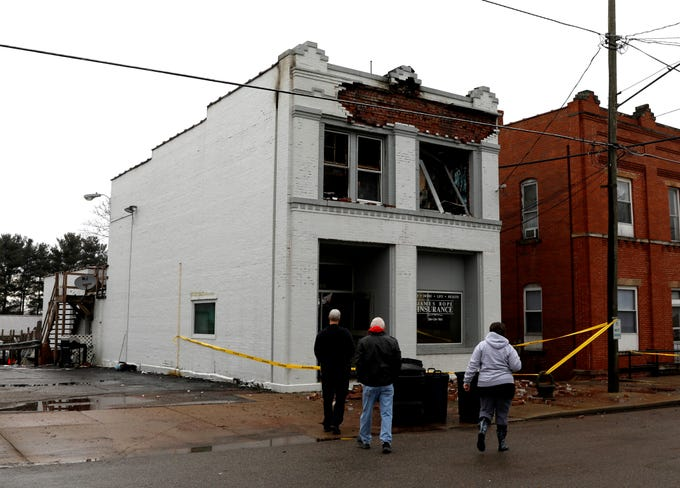 James Bope, center, walks up to a building he owns on Main Street in Rushville Friday morning, Jan. 4, 2019. The building caught fire Thursday evening and rekindled around 2:30 a.m. Friday. The roof and second floor collapsed during the rekindle. During the initial fire a woman was pulled from the second floor apartment by an off duty firefighter and another man.