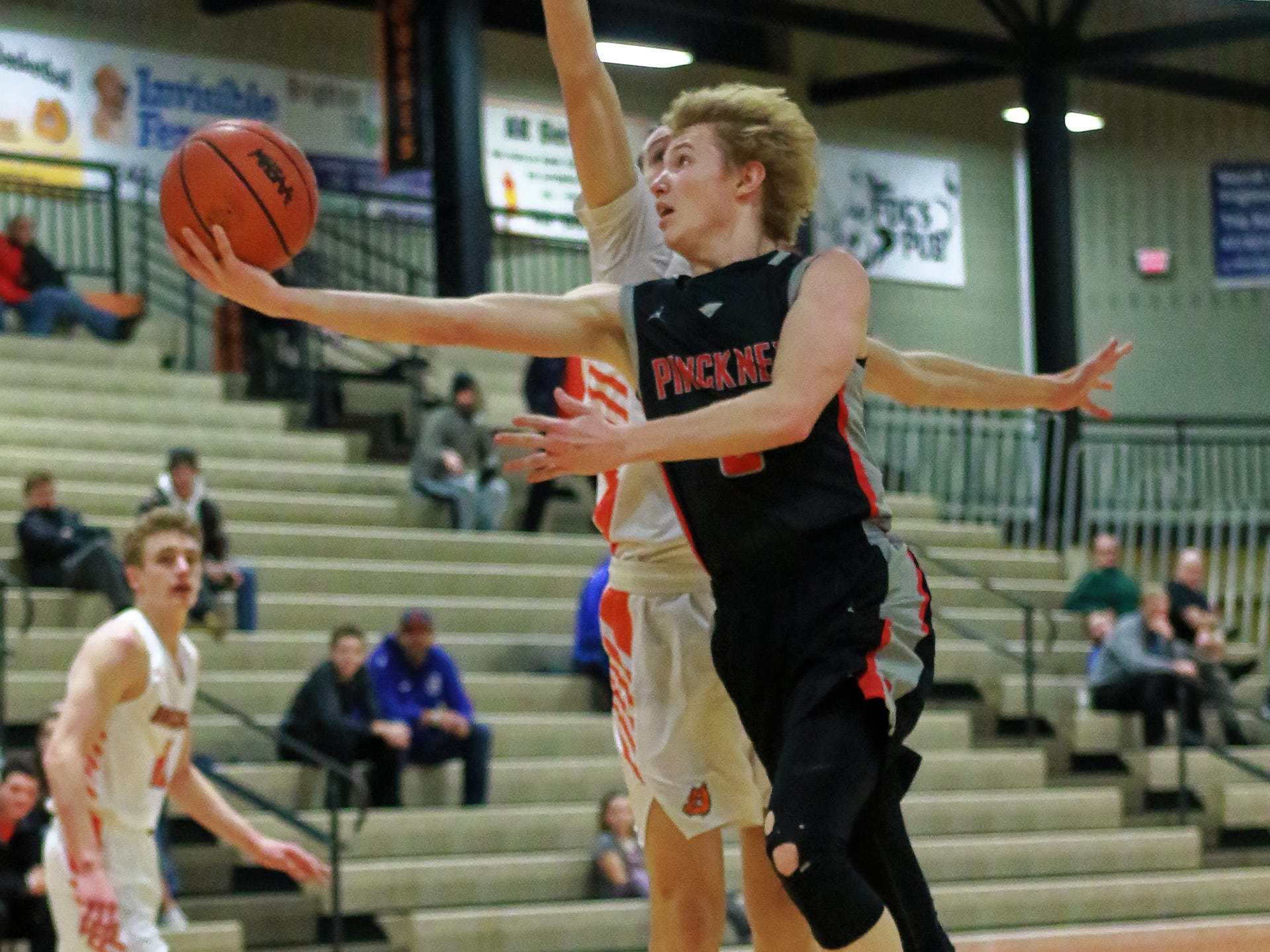 Pinckney's Kevin McCoy lays the ball up and around a Brighton in a 60-33 loss to the Bulldogs on Thursday, Jan. 3, 2019.