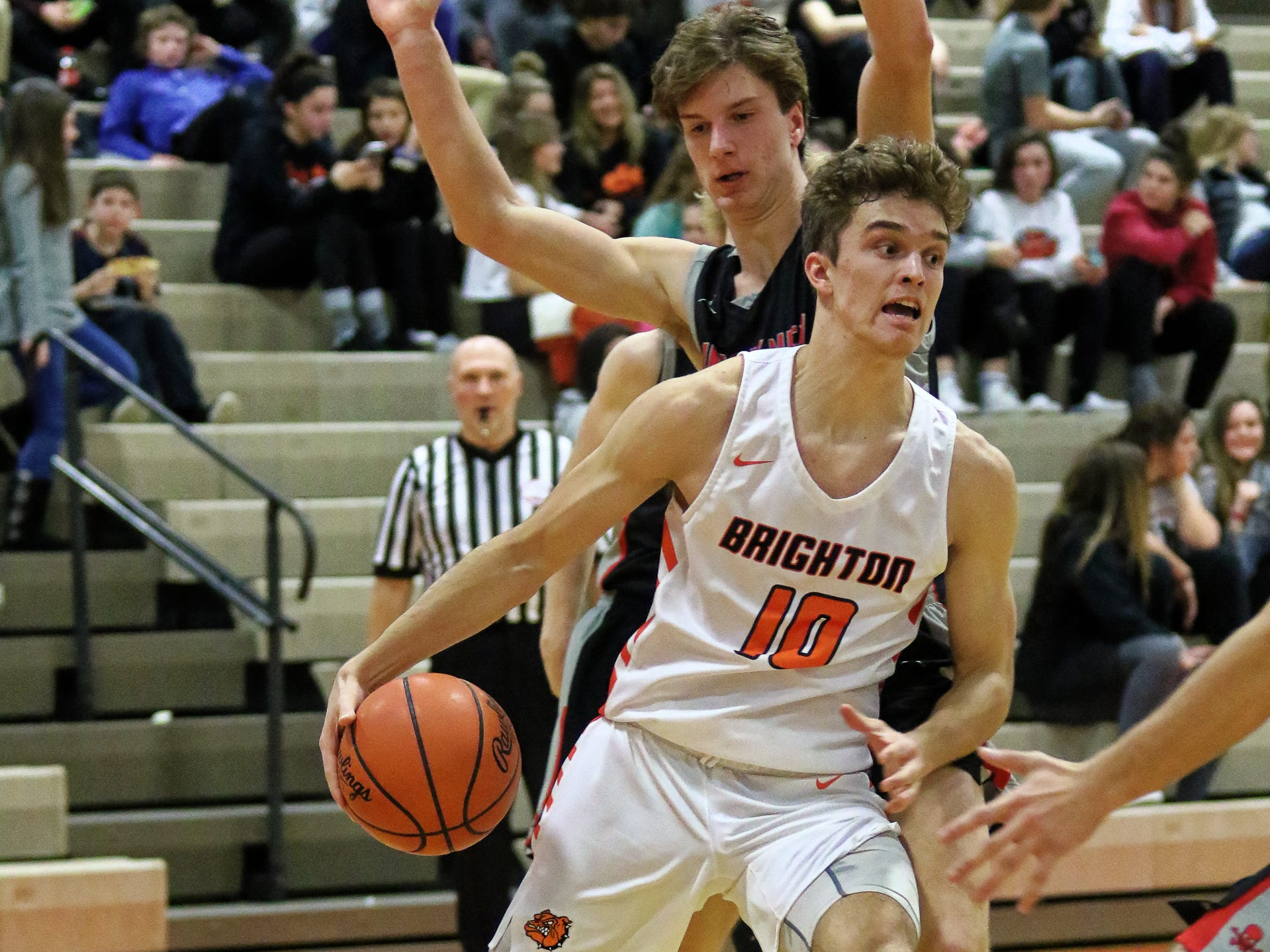 Brighton's Keenan Stolz drives the baseline in a 60-33 victory over Pinckney on Thursday, Jan. 3, 2019.