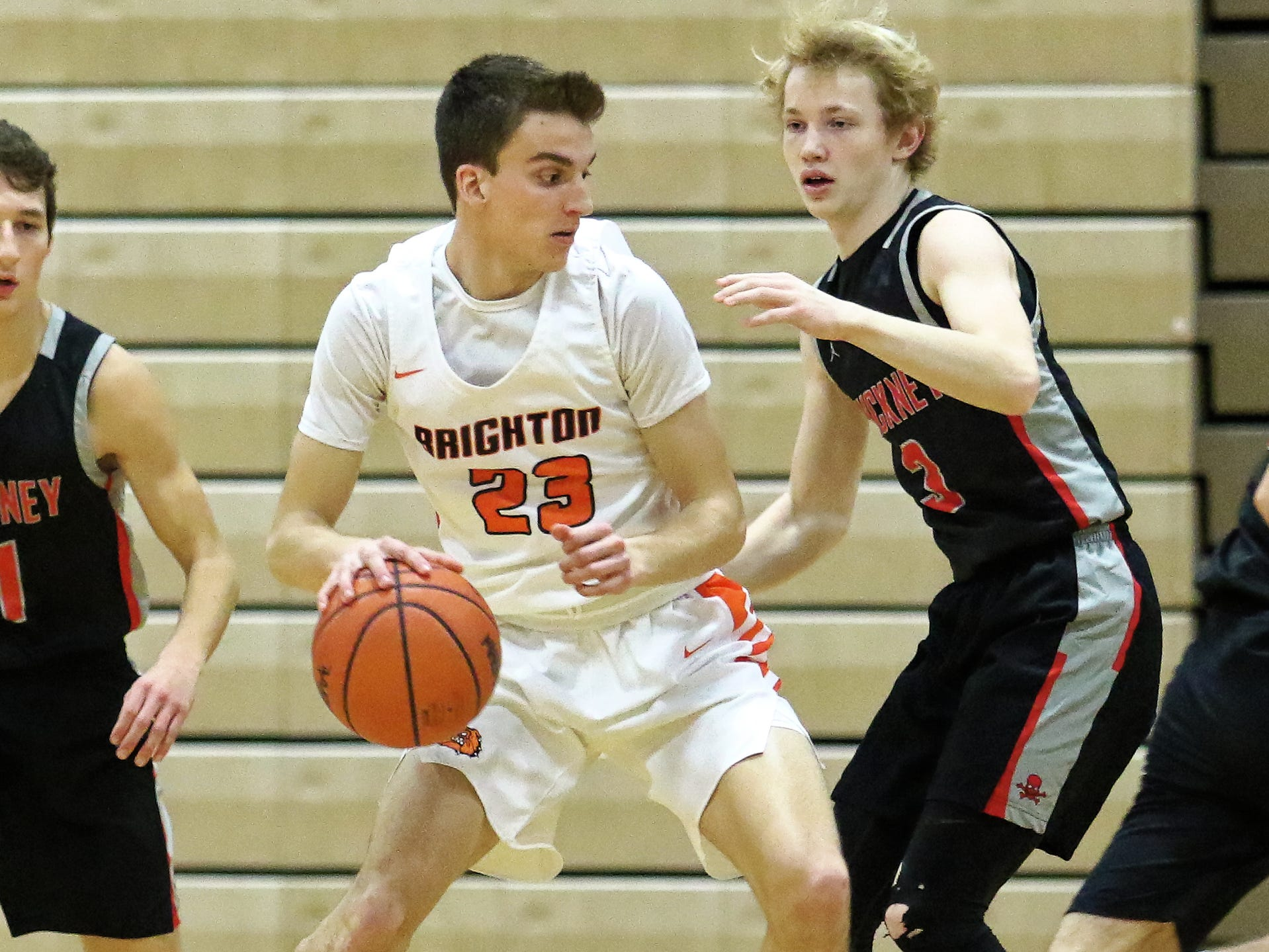 Brighton's Noah Bennett (23), who scored a game-high 14 points, tries to work past Pinckney's Kevin McCoy on Thursday, Jan. 3, 2019.